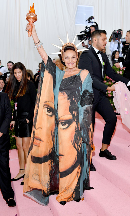 What's more iconic? - Fashion designer Diane von Fürstenberg as Statue of Liberty. What's more iconic? Printing her own face on the dress!