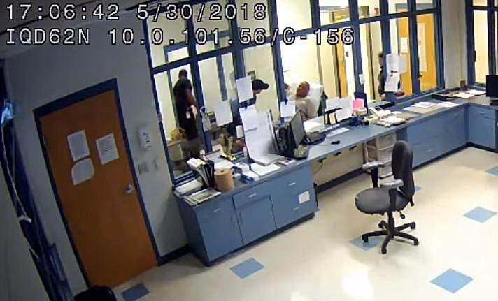 This is a screenshot of surveillance video footage taken from inside Erie County's work-release center. Inmate Felix L. Manus, at center, is loaded onto a stretcher after emergency personnel arrived at the Erie County work-release center on May 30. [CONTRIBUTED PHOTO]