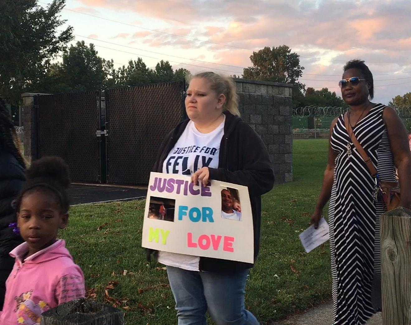 Amanda Tucholski, Felix Manus' longtime girlfriend, participates in a silent march in front of the Erie County work-release center, 450 E. 16th St., as part of a vigil in honor of Manus. Manus died June 11 after suffering an asthma attack during a work-release shift on May 30. [MADELEINE O'NEILL/ERIE TIMES-NEWS]