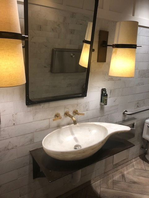 Love these faucets (if anyone knows the designer please let me know, I want for our remodel!)- but so much to touch in this pretty bathroom