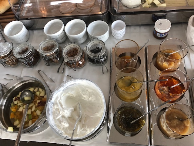 the yogurt station at breakfast buffet - all the marmalades on the right are incredible, the carrot was our fave!