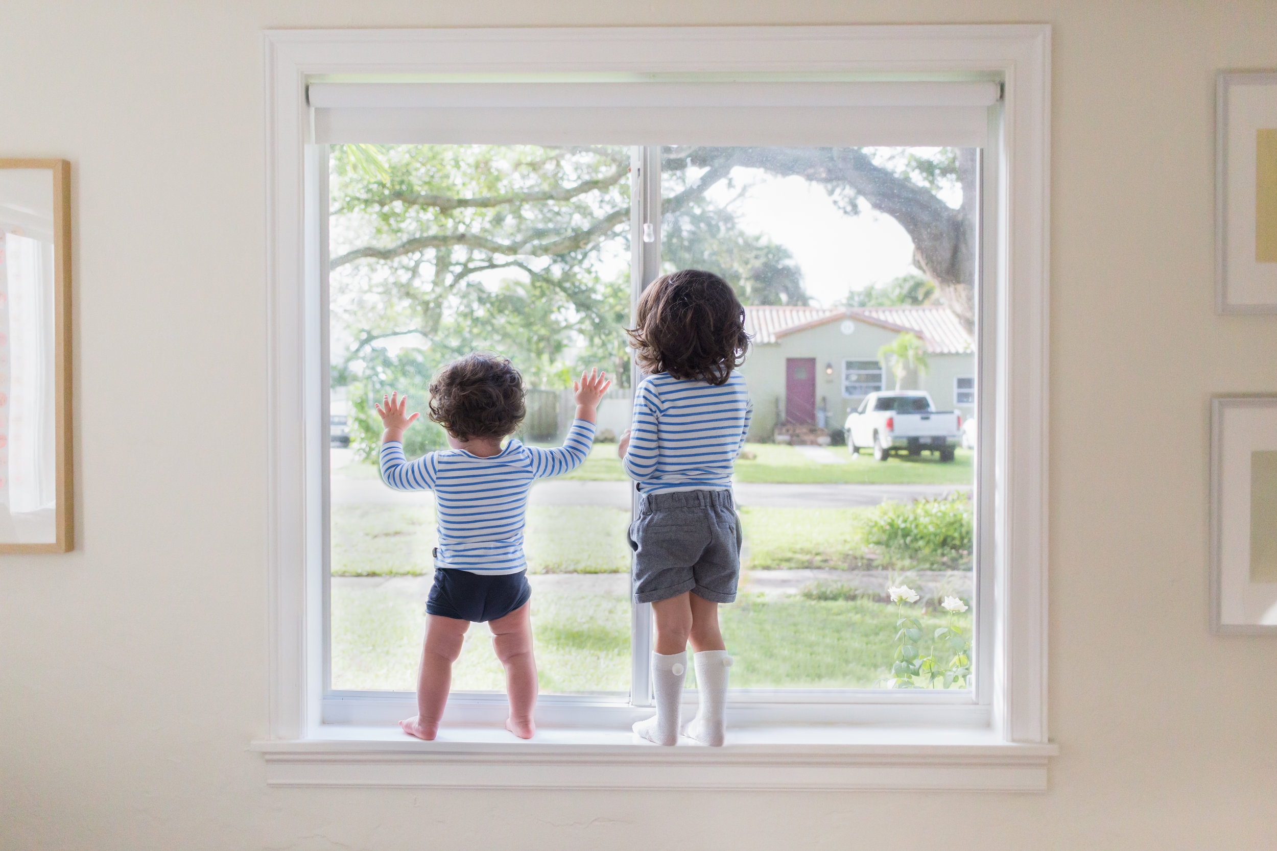 (NOTE: This is a composite image. Mom and Dad were right below the children. A seperate image of the window was taken afterwards. The children were never in any danger.)
