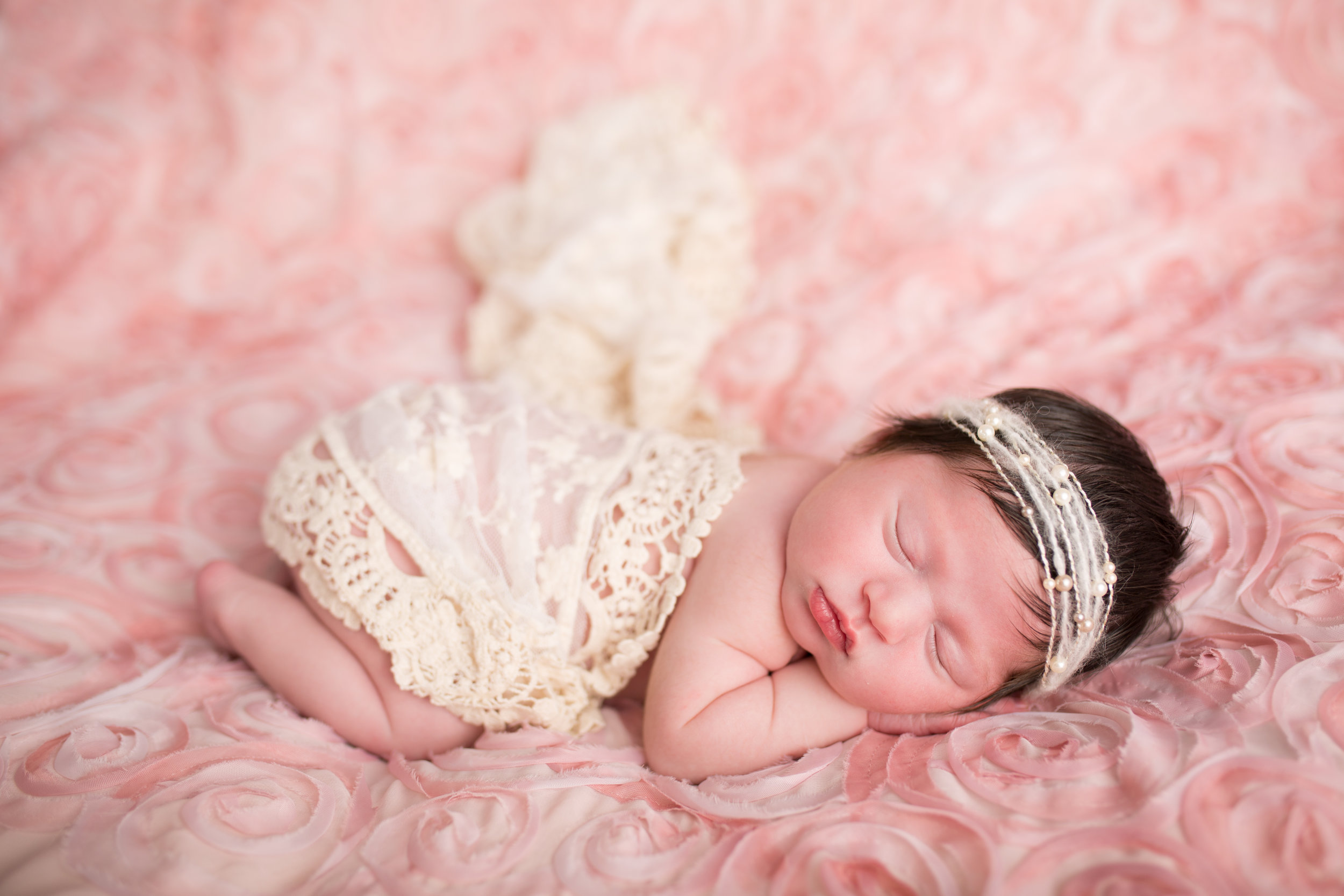 newborn sleepy pose