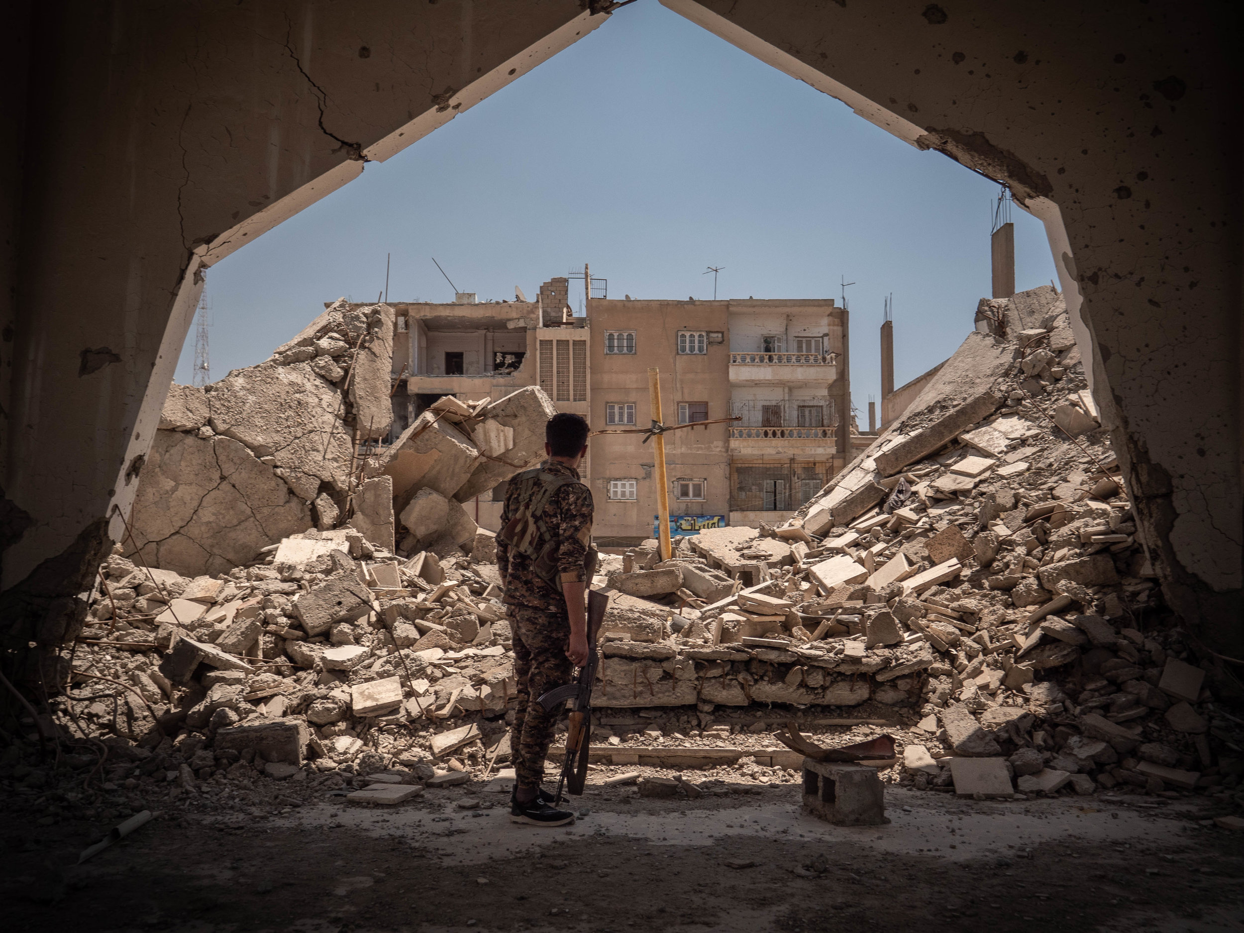 29/05/19, Raqqa, Syria - A member of the security forces inside a destroyed church in Raqqa.
