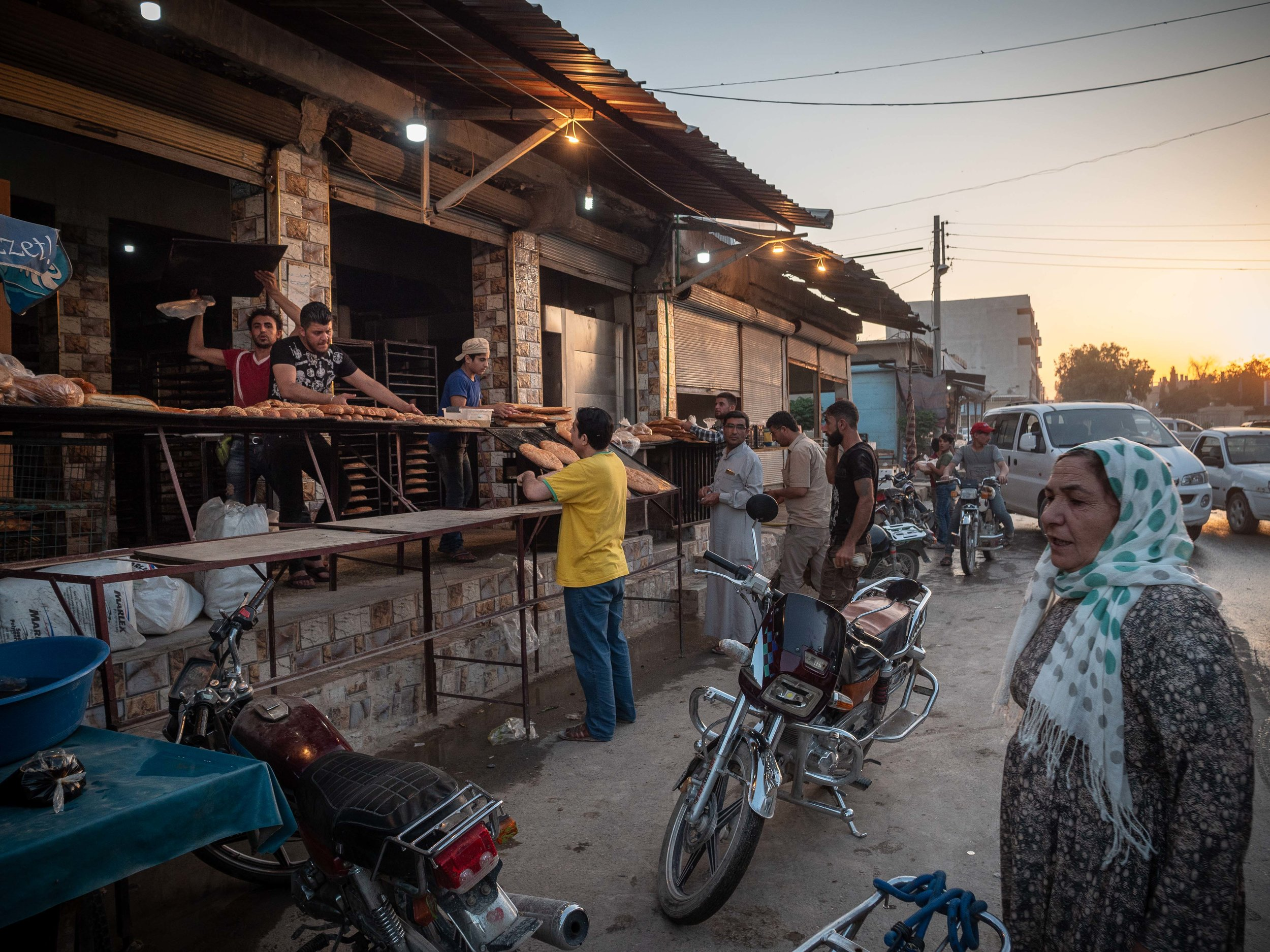 28/05/19, Kobane, Syria - A bakery selling bread on the street in the evening.