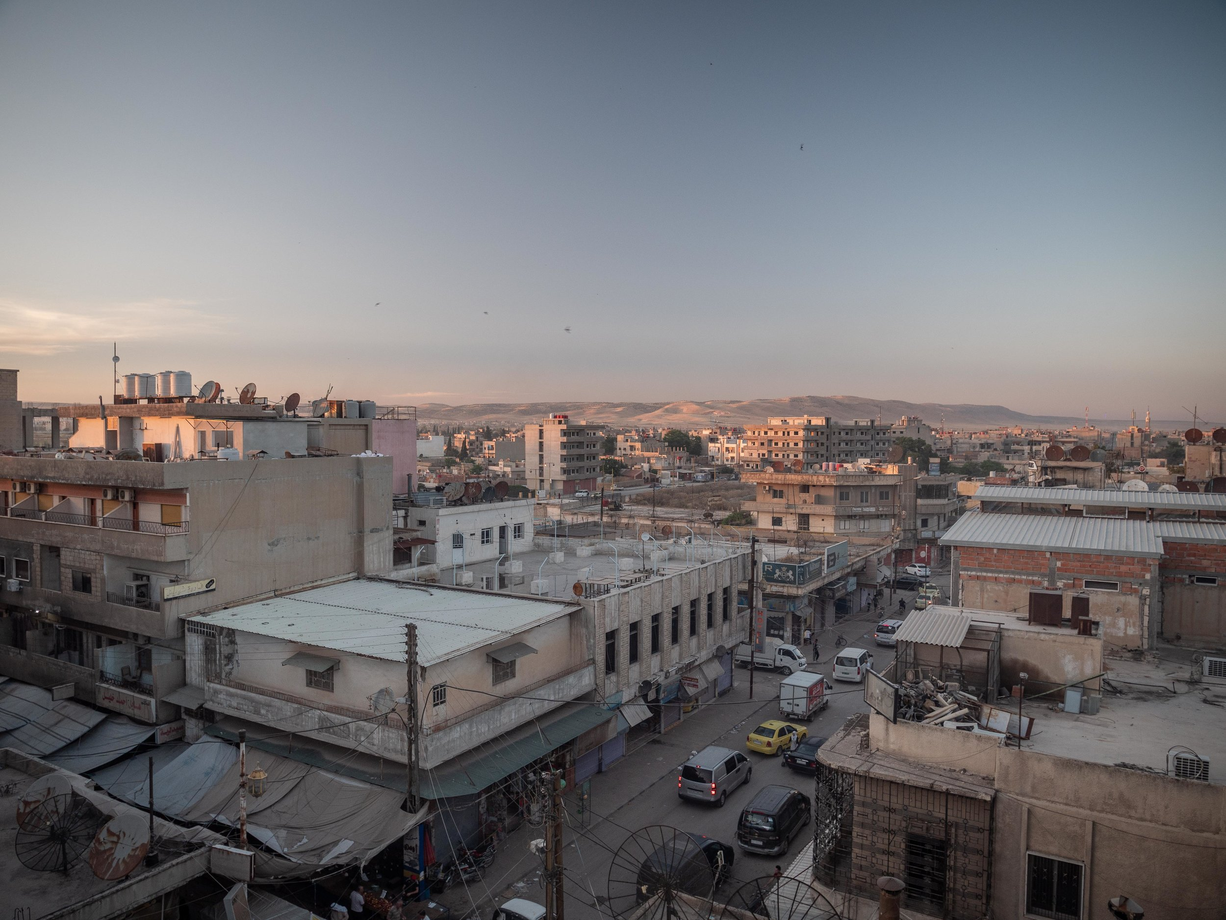 30/05/19, Al Qamishli, Syria - A view of Qamishli, in Syria. The city is divided in two, with the SDF ruling the larger part of the city and the regular Syrian army loyal to Assad ruling over the airport area.