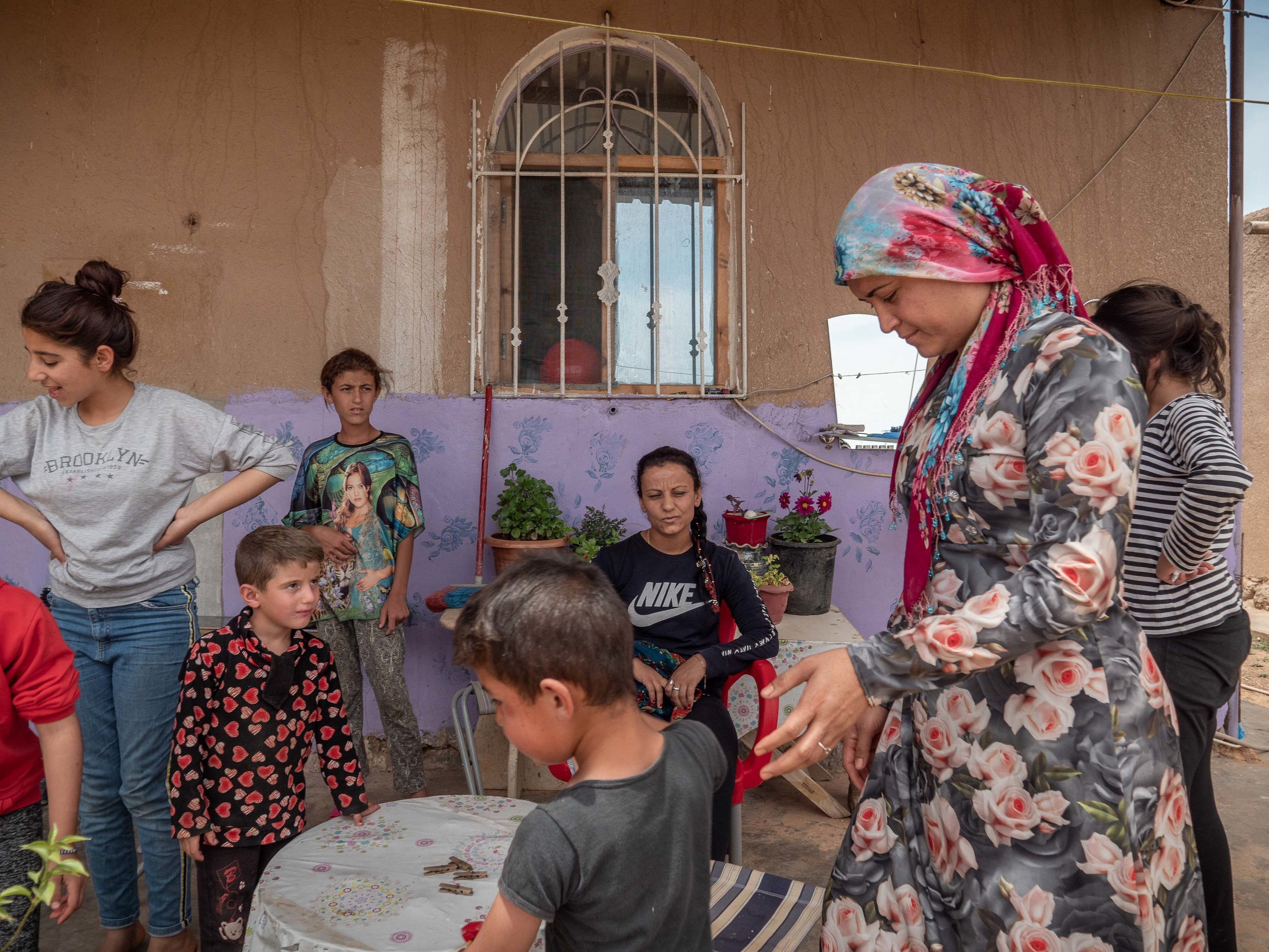 31/05/19, Jinwar, Syria - A group of women and their children in Jinwar. only women are allowed to live in the village of Jinwar, who was founded to give shelter to widows and women who suffered domestic violence.
