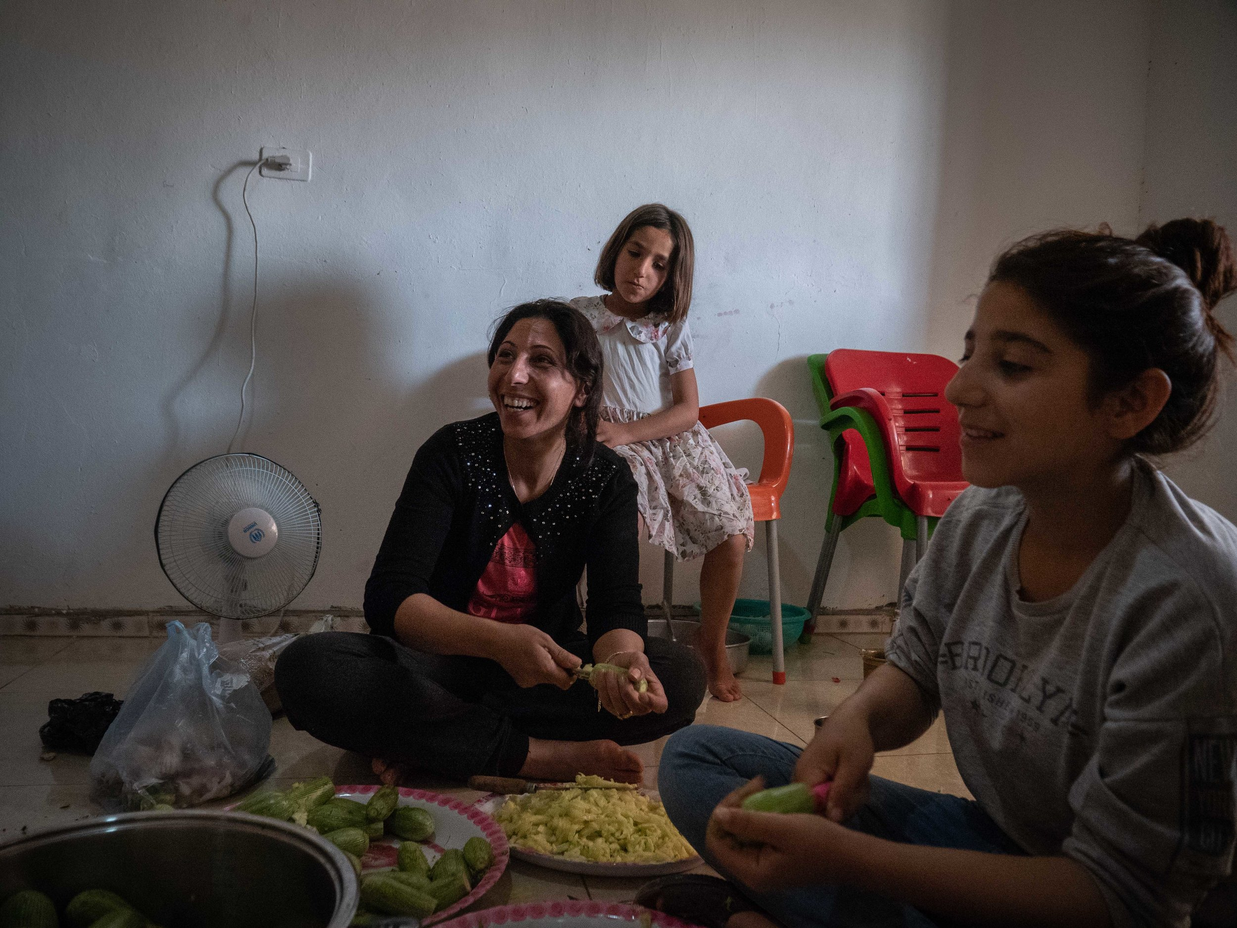 31/05/19, Jinwar, Syria - Fatma, the widow of a YPG martyr, prepares traditional food in her home in the village of Jinwar.