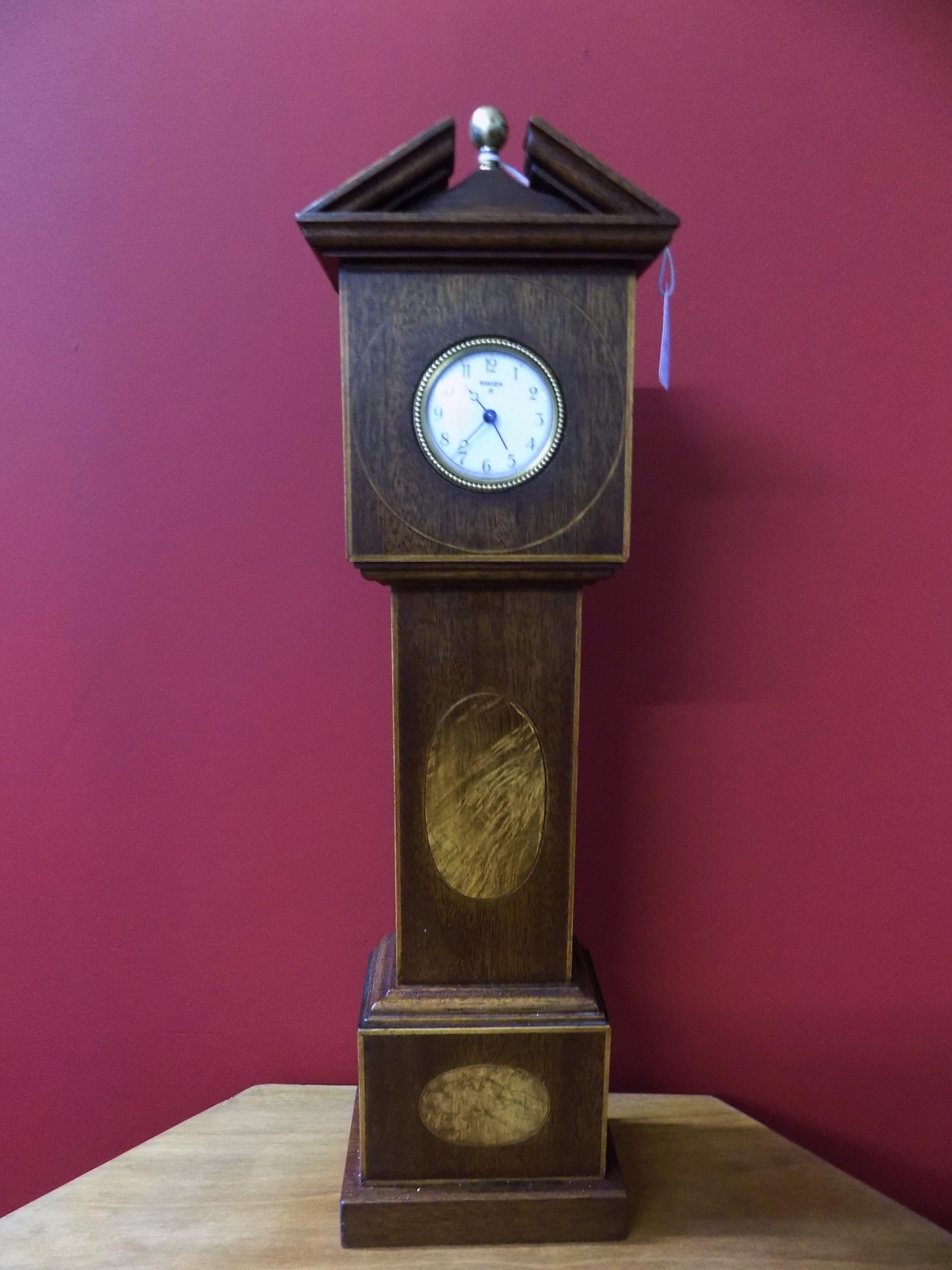 A miniture mahogany Grandfather clock £90.00