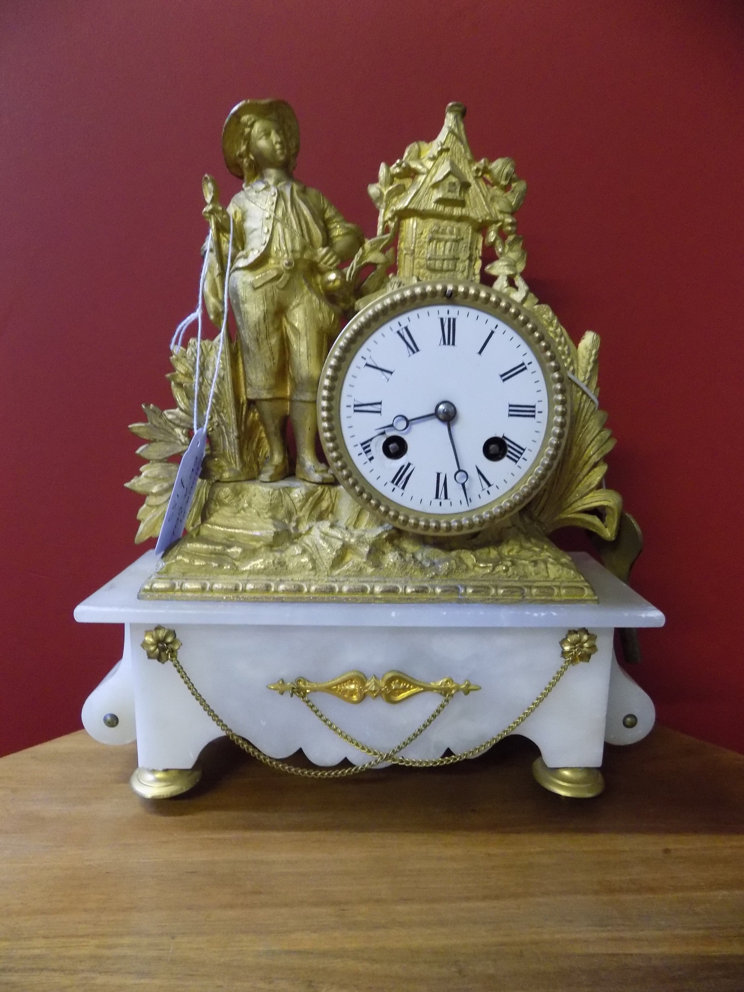 French gilt and alabaster mantel clock £155.00