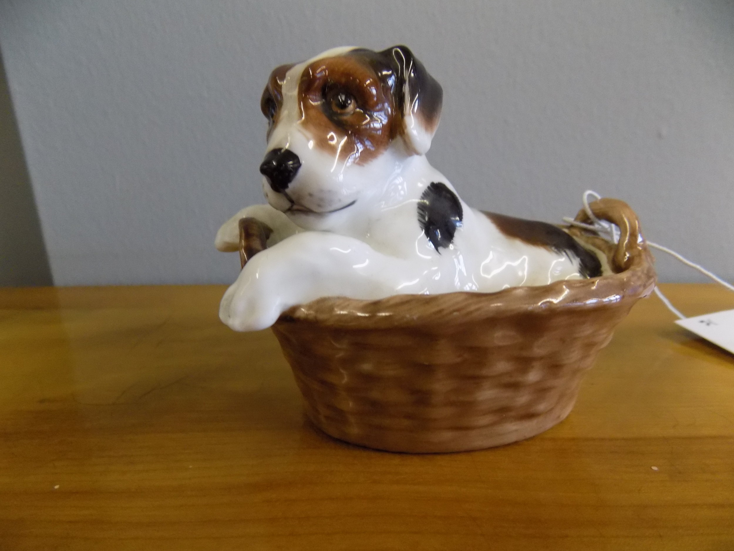 Royal Doulton puppy in a basket £65.00
