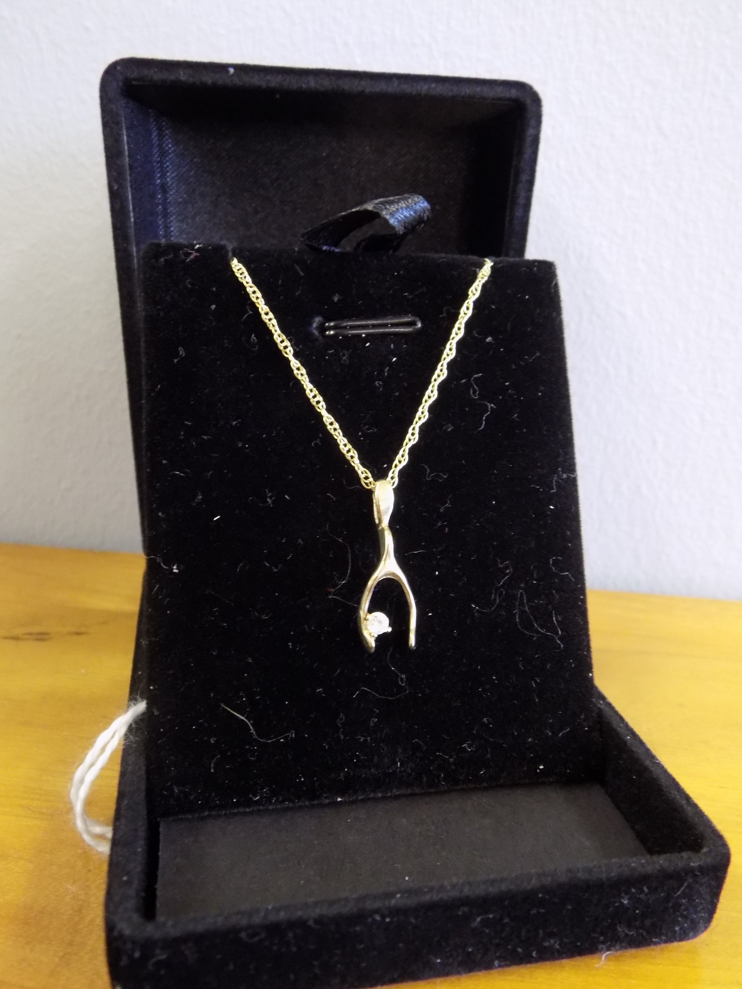 9ct gold and diamond wishbone necklace £125.00