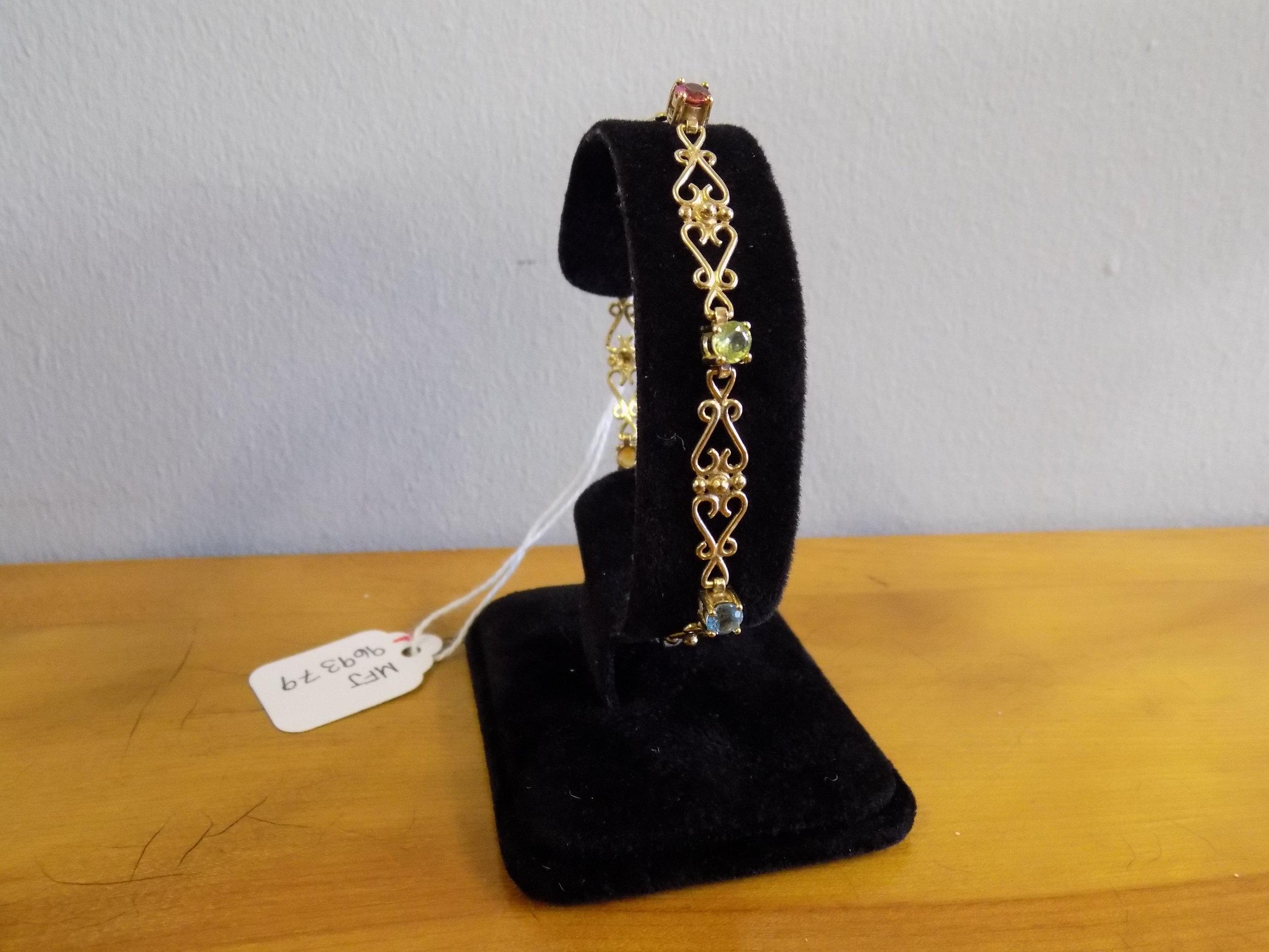 9ct gold heart and gem set bracelet £195.00