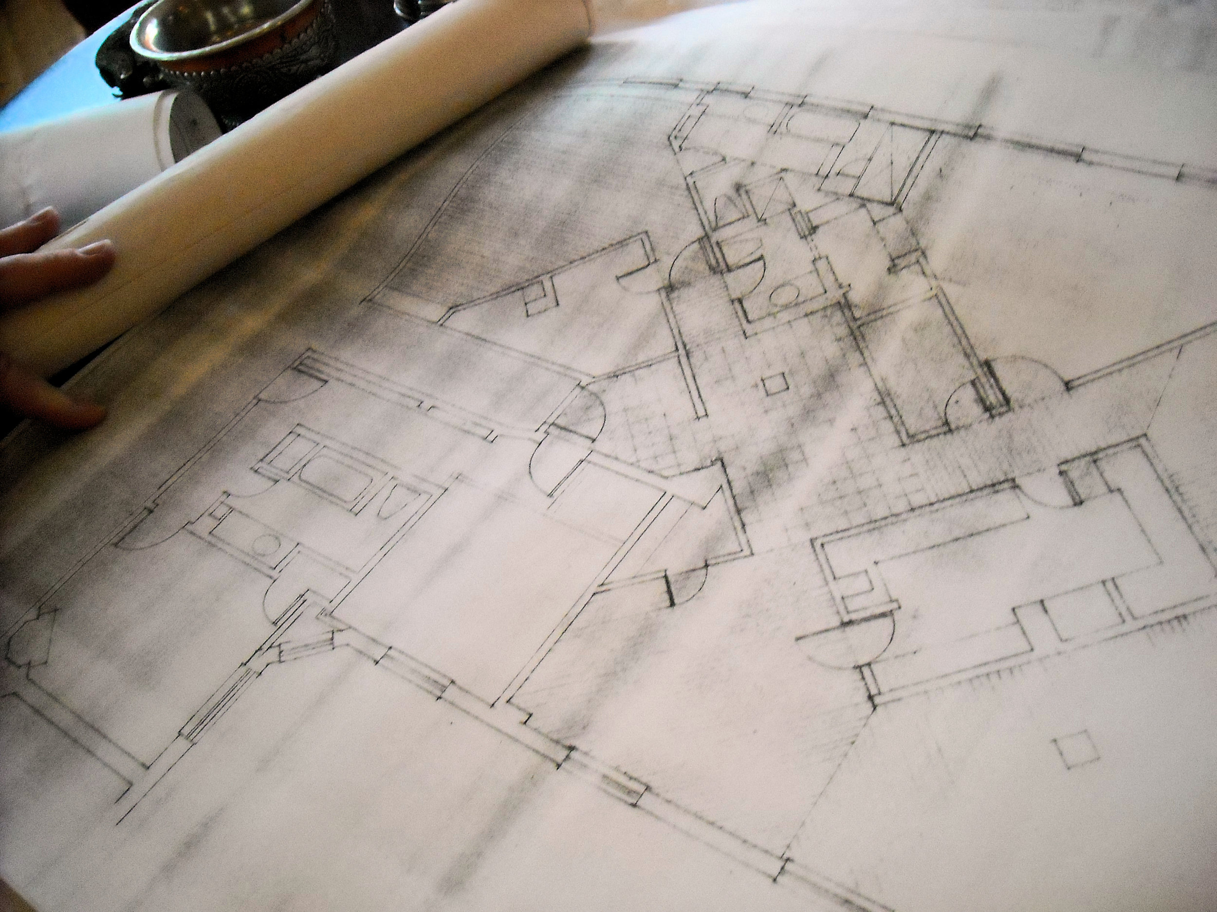 The owner of the Bernstein/Ephron penthouse apartment shows me the blueprints for it.