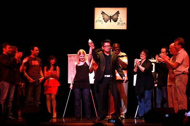 Shrake far left as winner (not Shrake) announced at The Moth GrandSlam Detroit (1st one) at Gem Theater, Detroit, MI