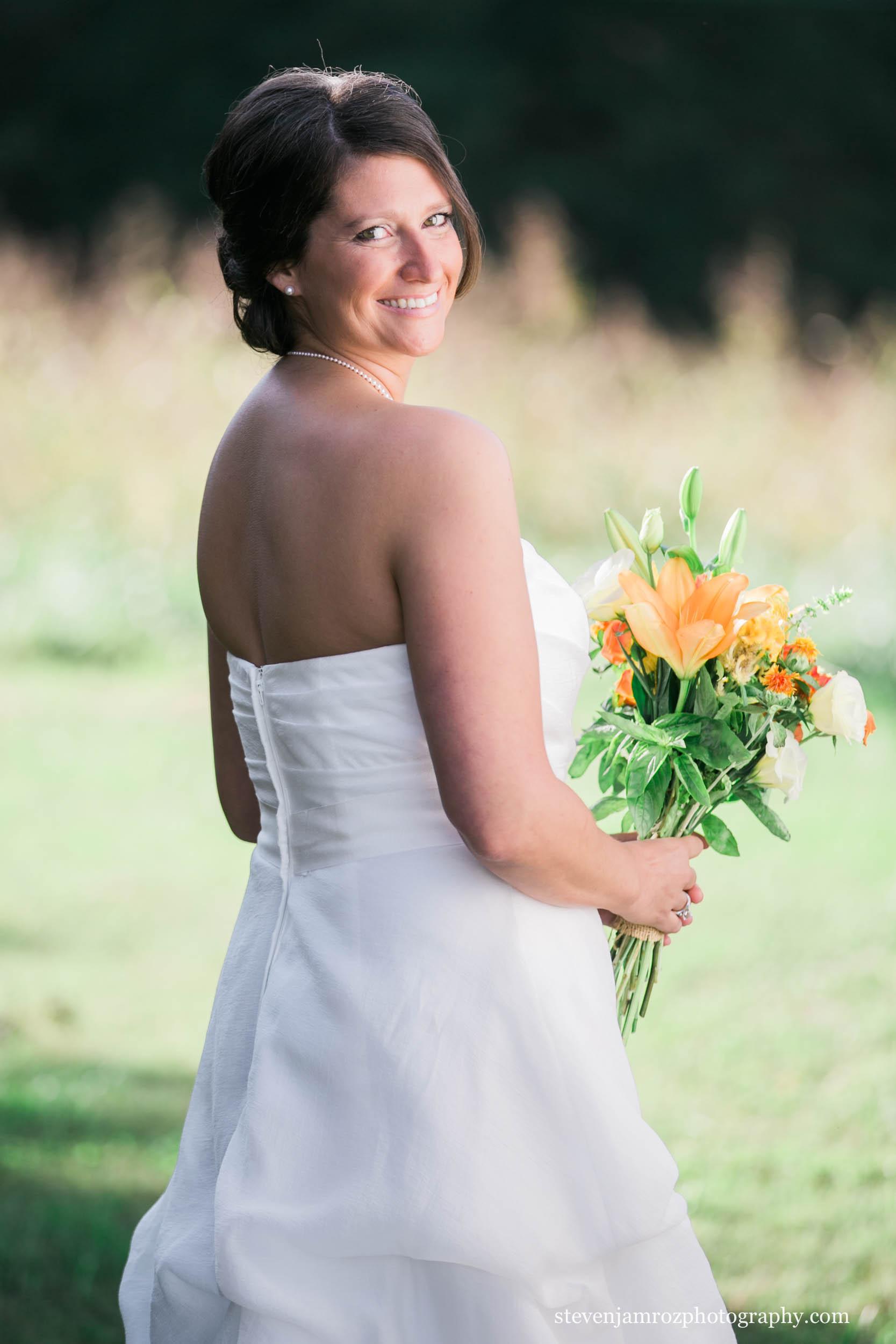 looks-over-shoulder-bride-wedding-snipes-farm-chapel-hill-0783.jpg