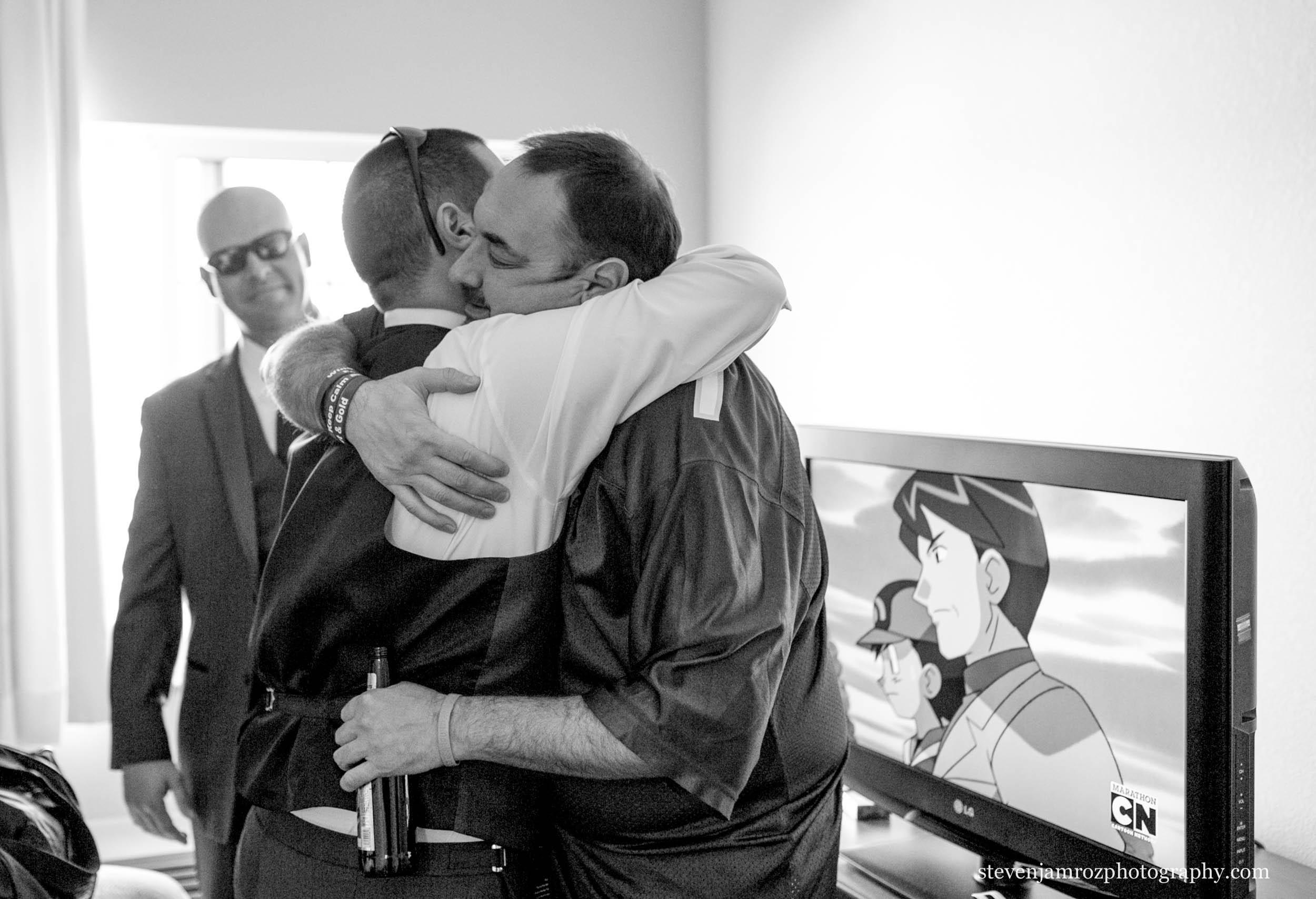 best-man-hugs-groomsman-before-wedding-0836.jpg