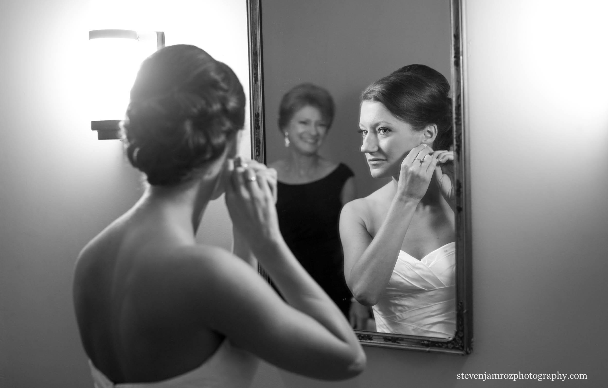 bride-gets-ready-as-mom-looks-in-mirror-raleigh-wedding-0833.jpg