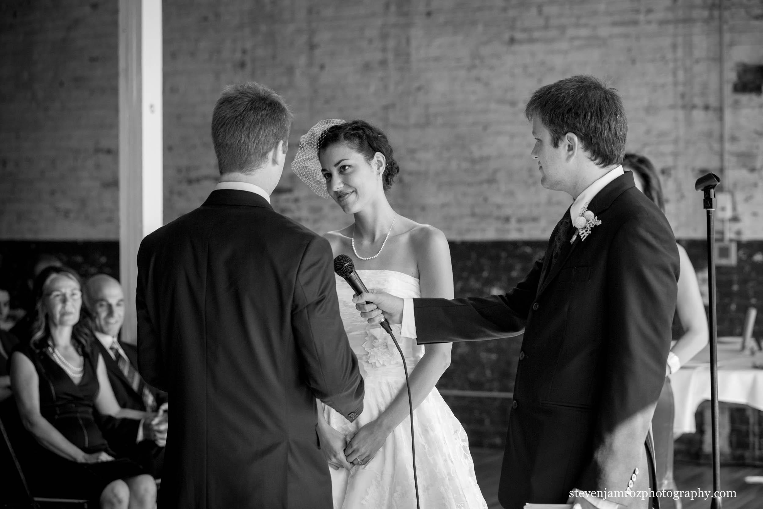 bride-groom-walking-yates-mill-wedding-venue-0818.jpg