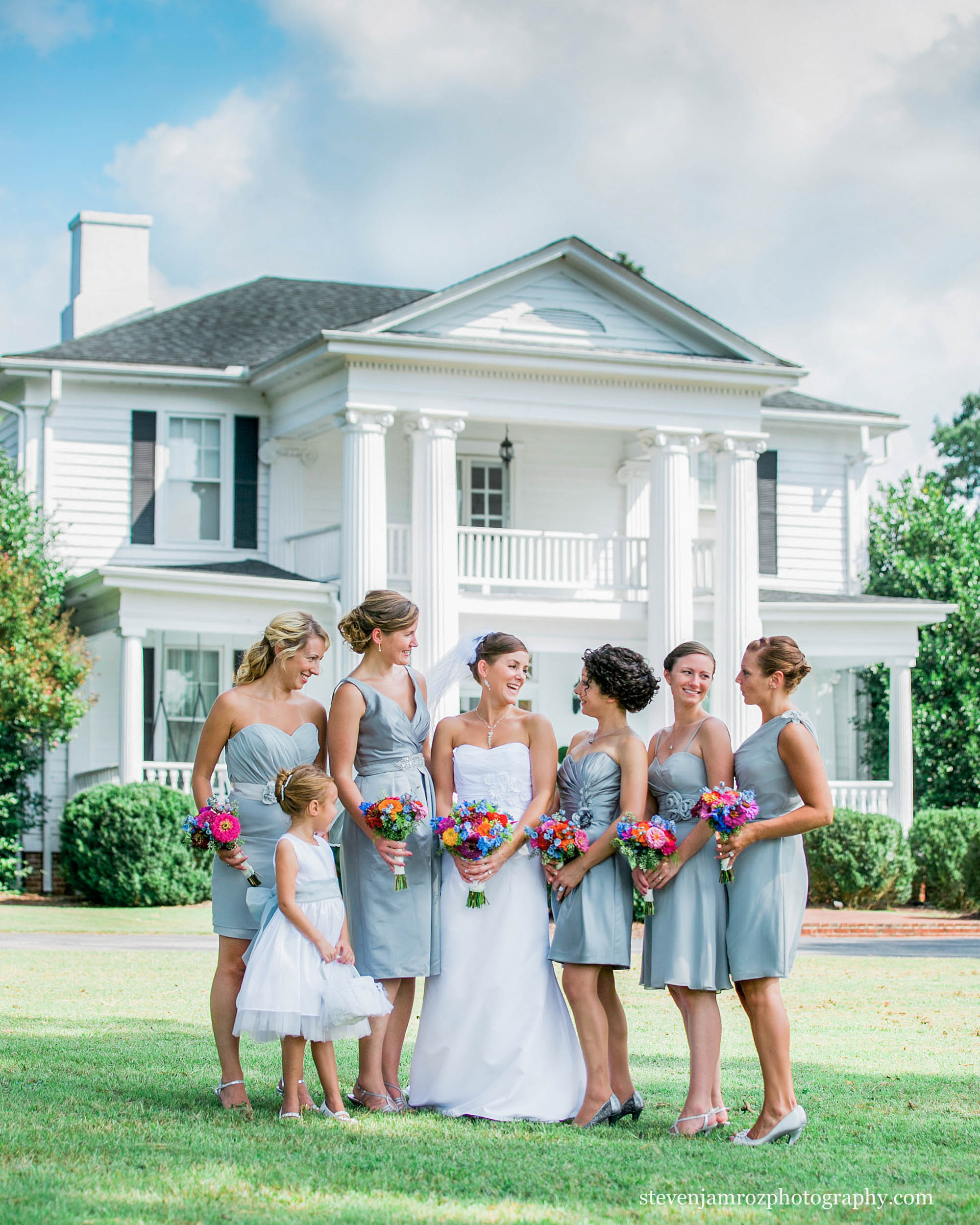 bridesmaids-and-bride-in-front-of-hudson-manor-estate-louisburg-nc-0861.jpg