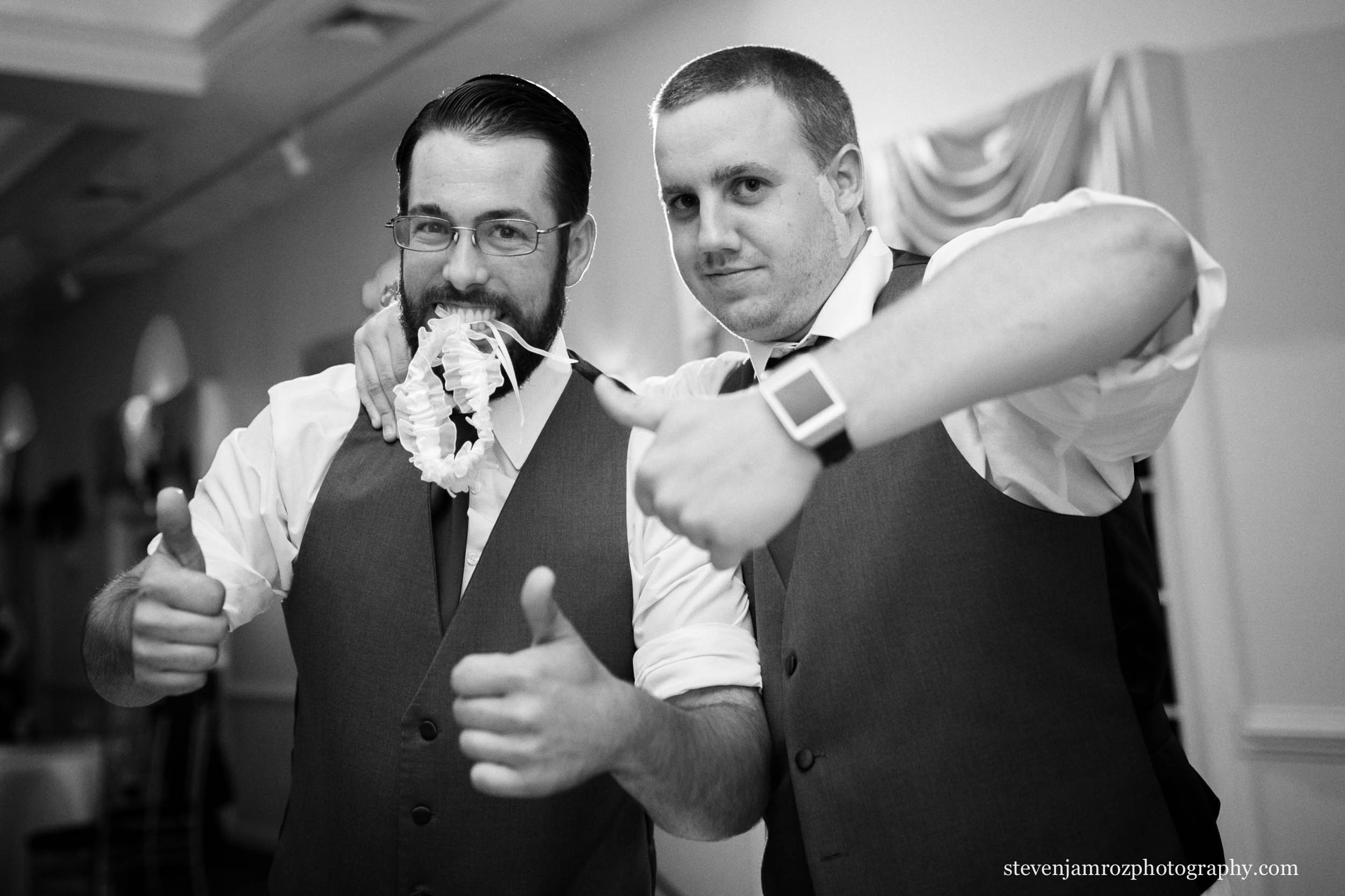 catches-garter-in-mouth-raleigh-wedding-steven-jamroz-0749.jpg