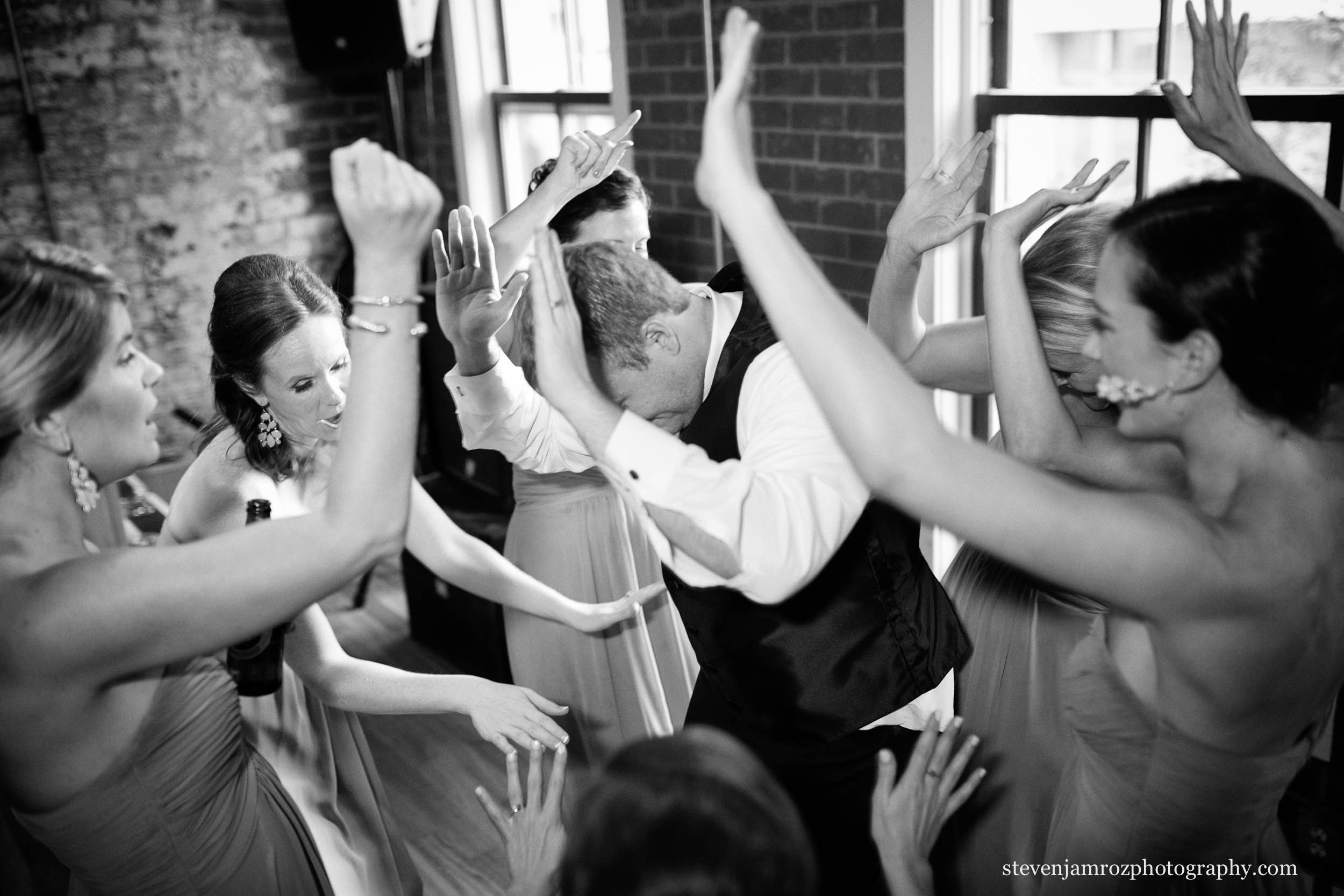 girls-circle-dance-around-groom-wedding-busy-bee-steven-jamroz-photography-0026.jpg