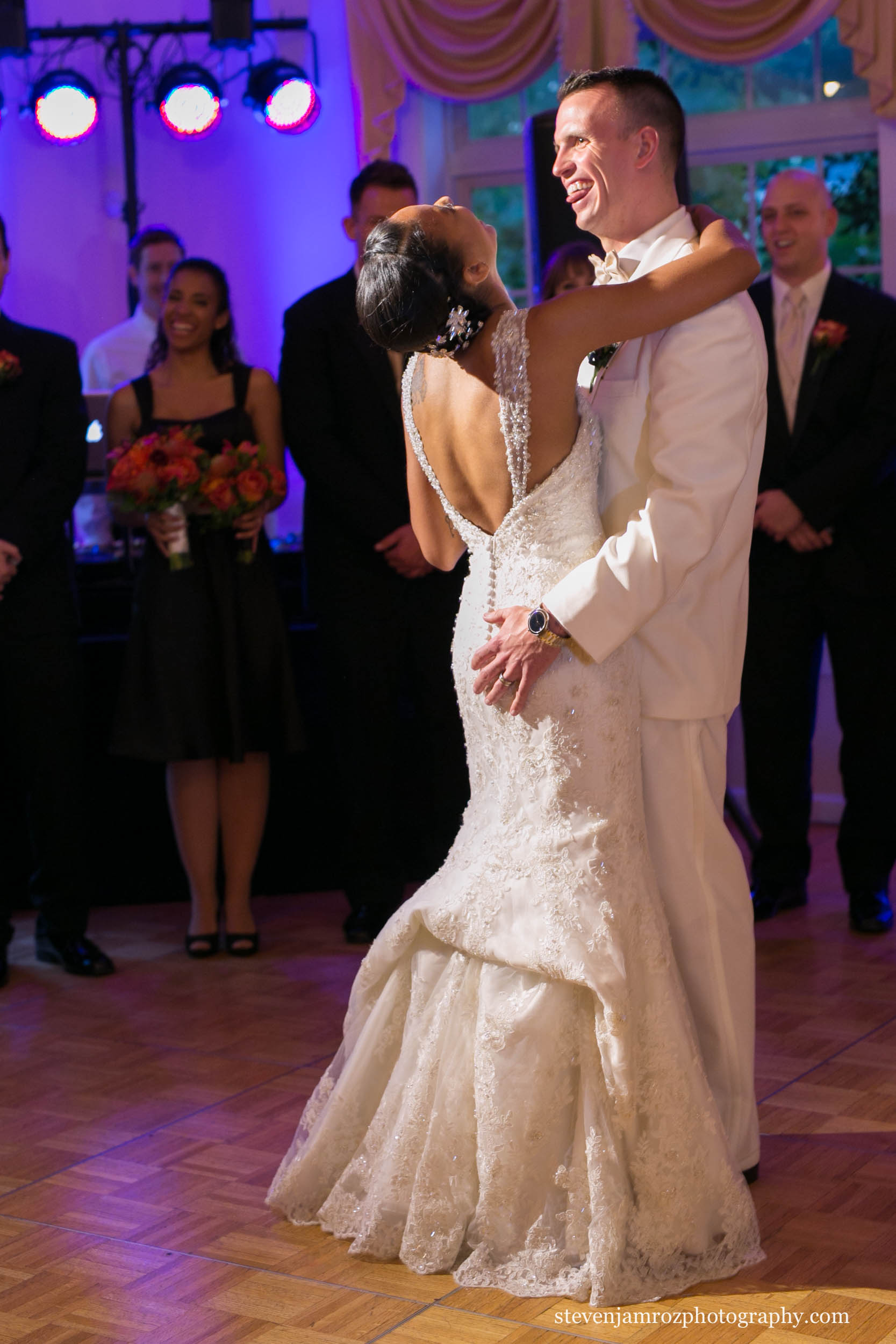 groom-grabs-brides-butt-first-dance-raleigh-photojournalism-0798.jpg