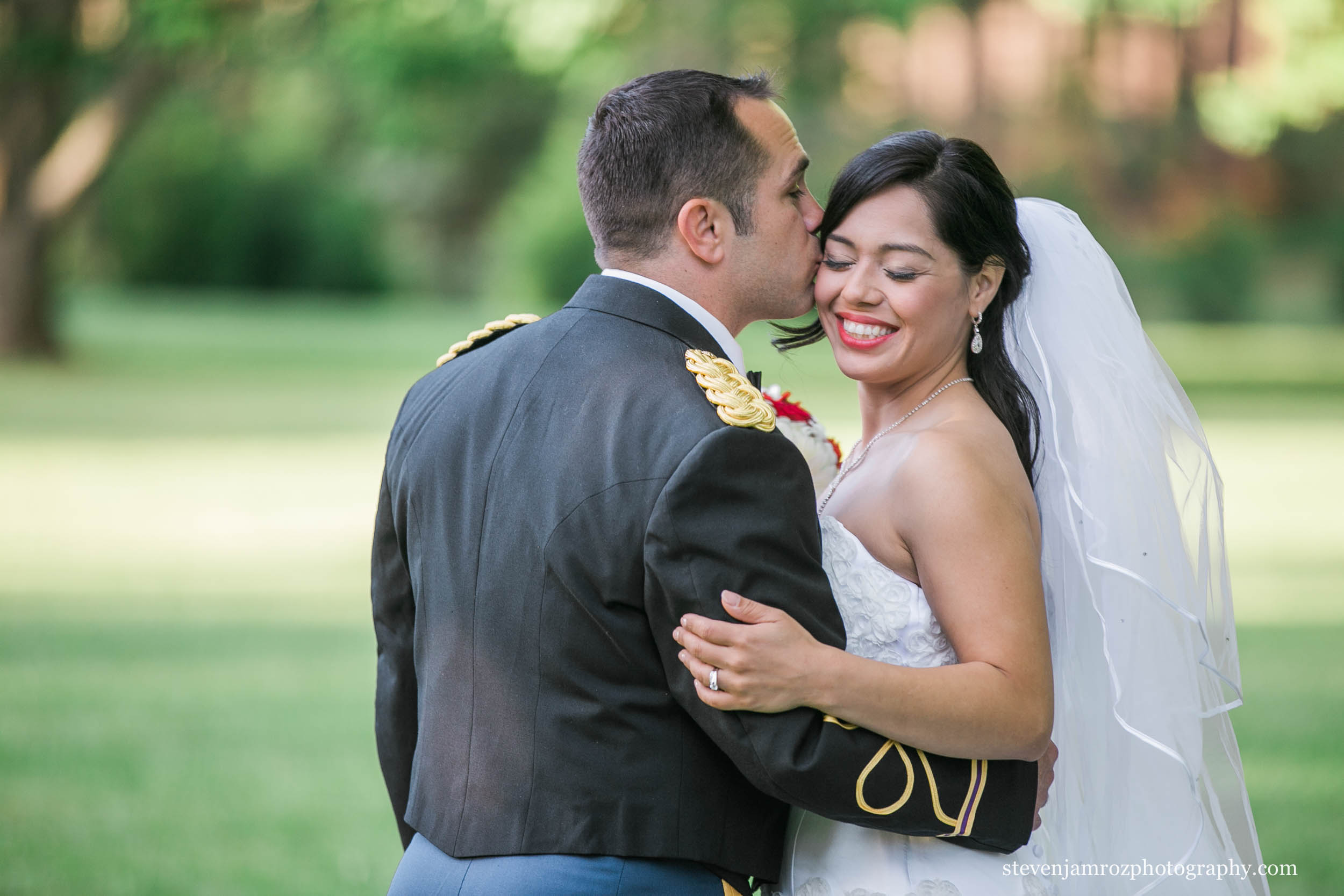 groom-kisses-bride-warrenton-nc-wedding-0111.jpg