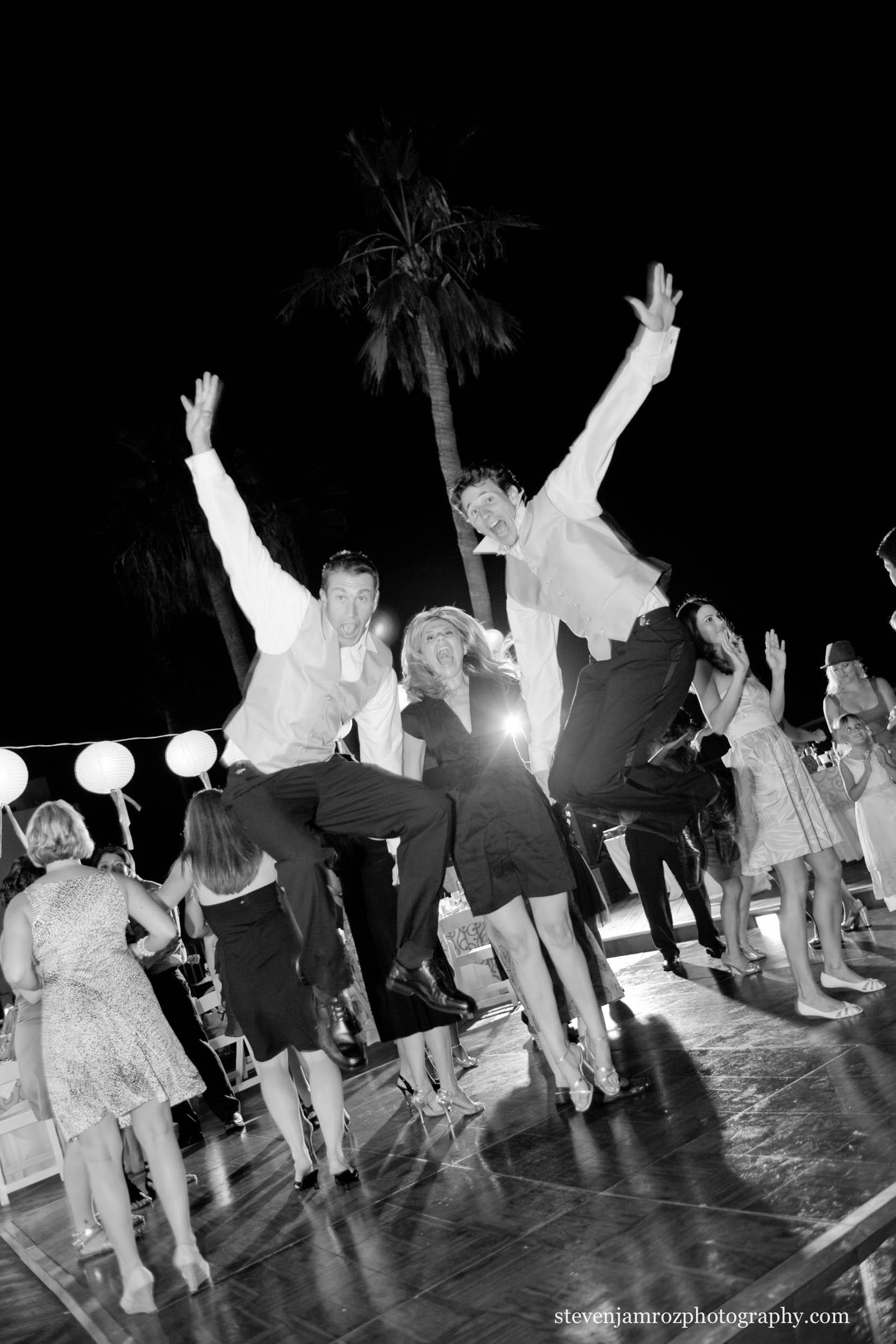 jumping-groomsmen-during-wedding-reception-raleigh-nc-0882.jpg