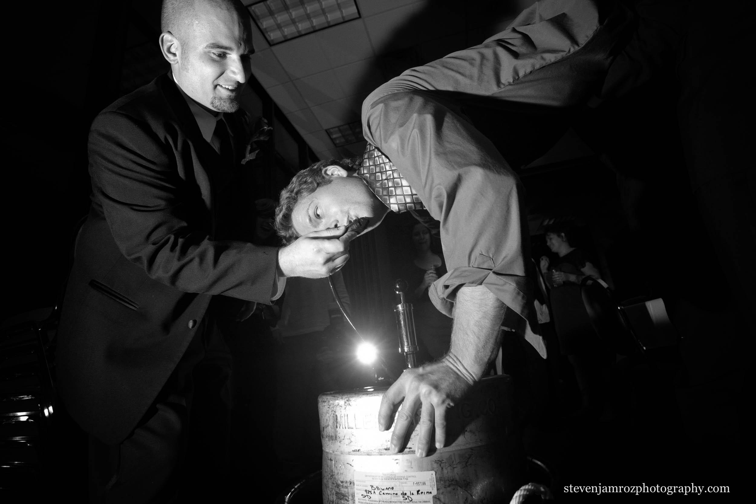 keg-stand-beer-raleigh-wedding-groomsman-photographer-0762.jpg