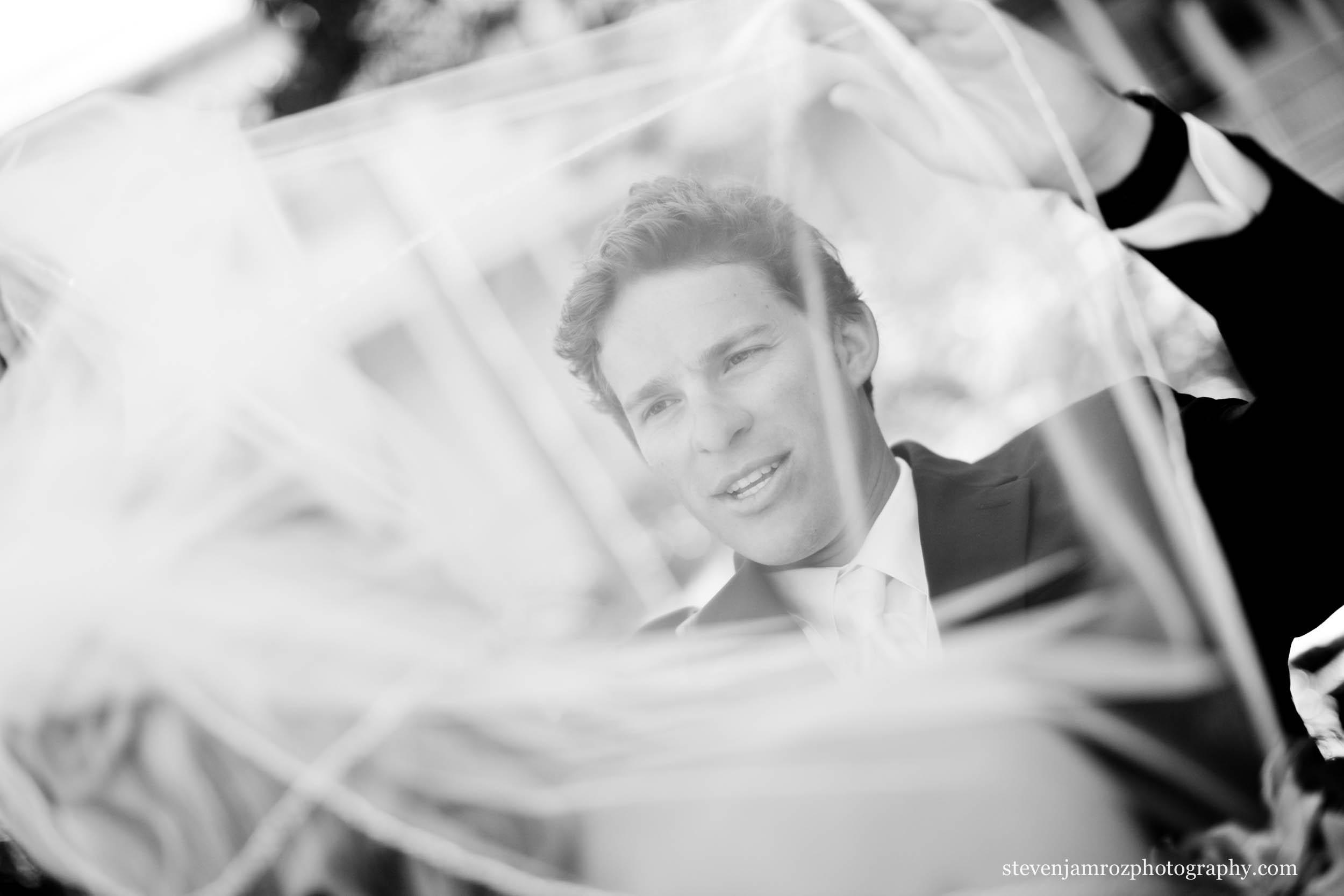 lifting-veil-on-bride-groom-wedding-raleigh-0120.jpg