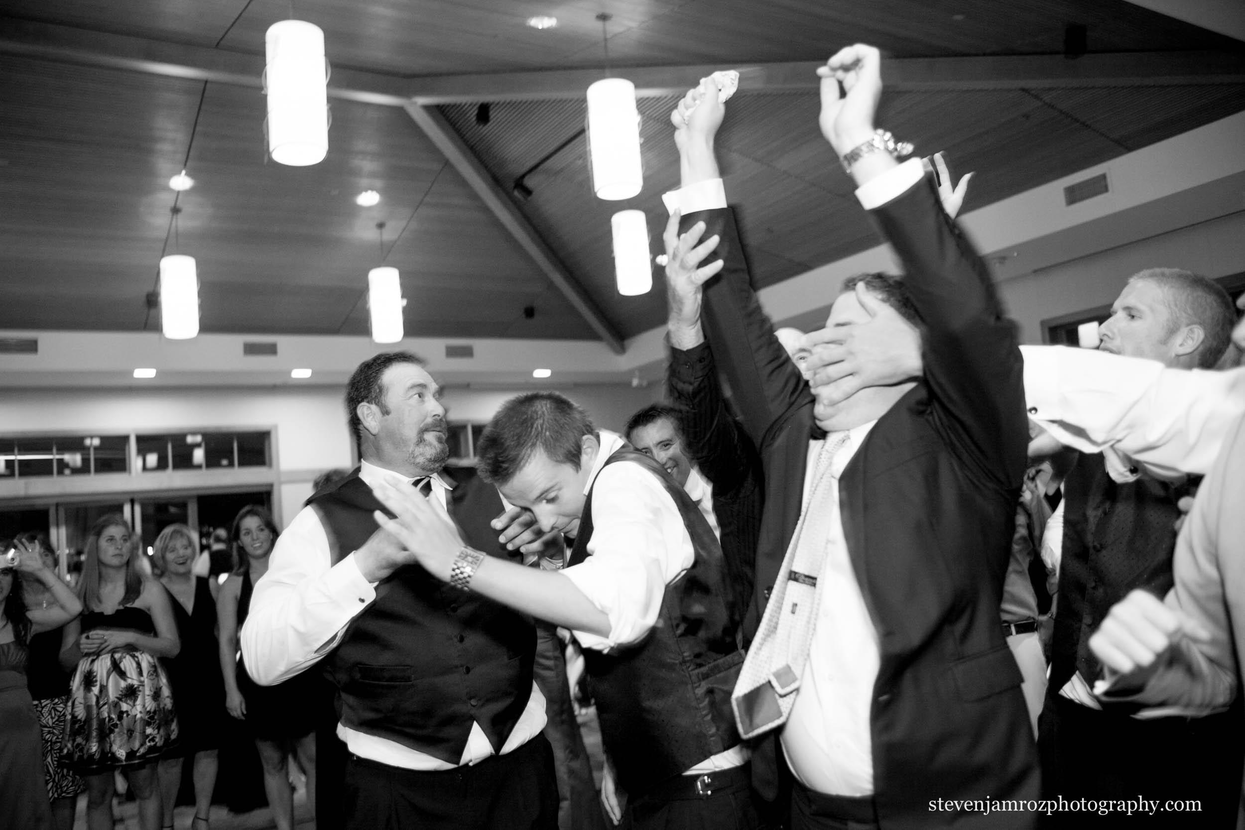 man-catches-garter-raleigh-wedding-steven-jamroz-photography-0560.jpg