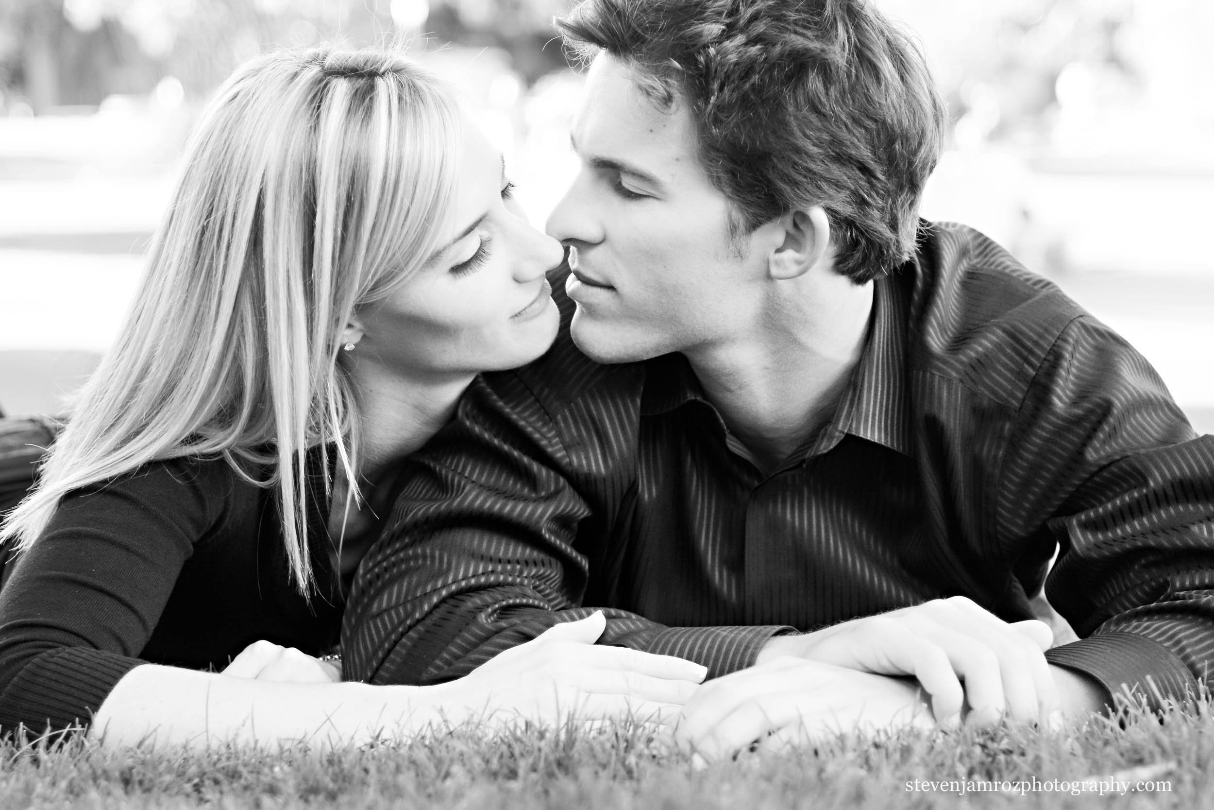 couple-snuggles-on-grass-raleigh-engagement-photography-0005.jpg