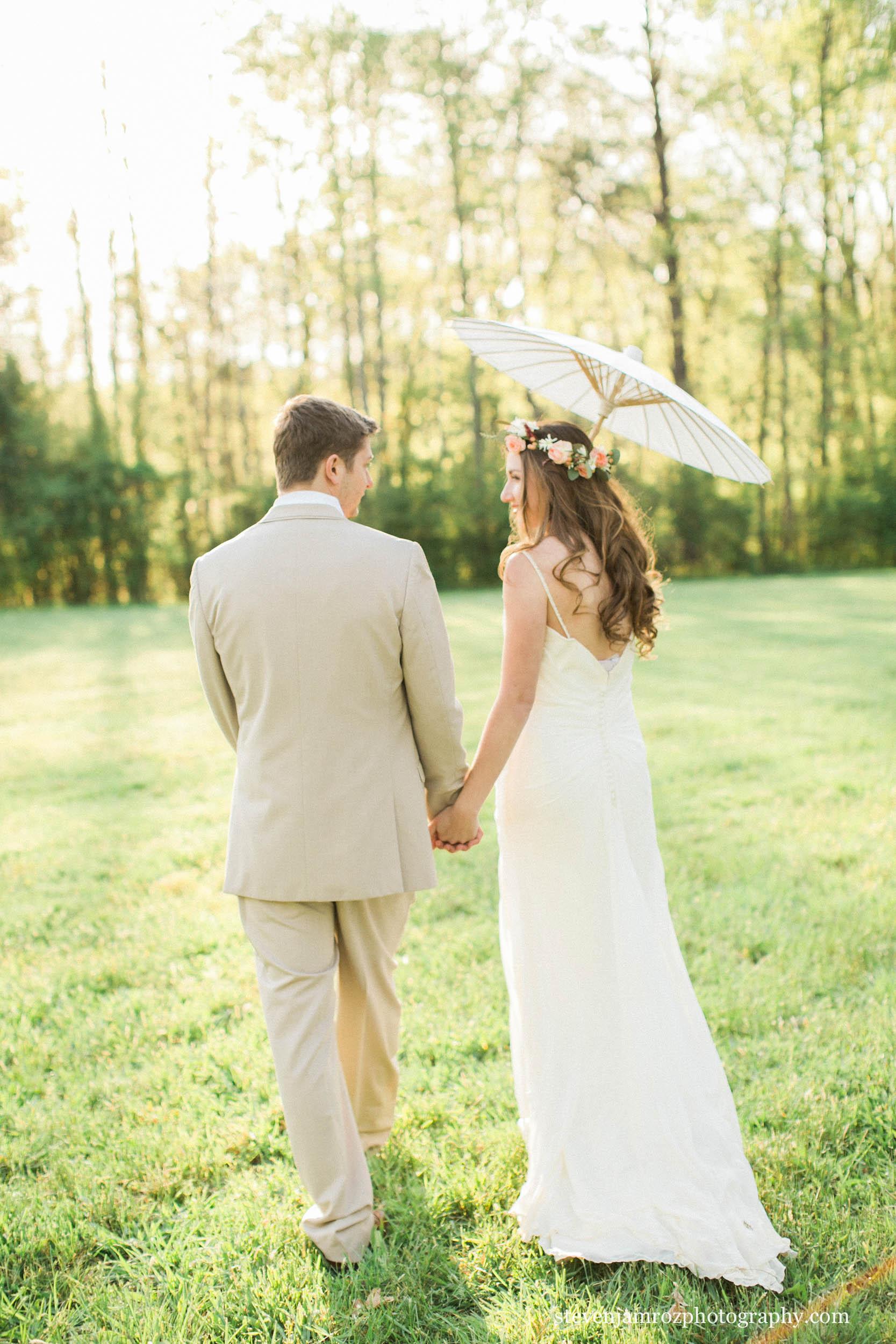 bride-groom-walking-cedar-grove-acres-wedding-styled-shoot.jpg