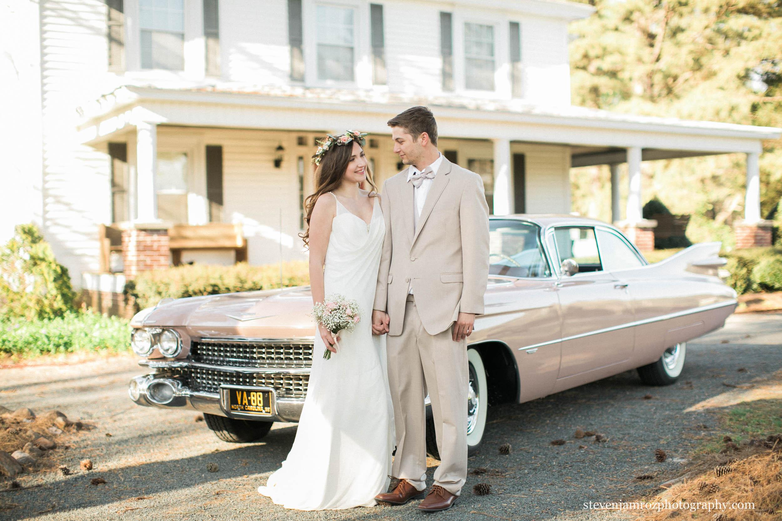 pink-cadillac-flowers-wedding-couple-cedar-grove-acres.jpg