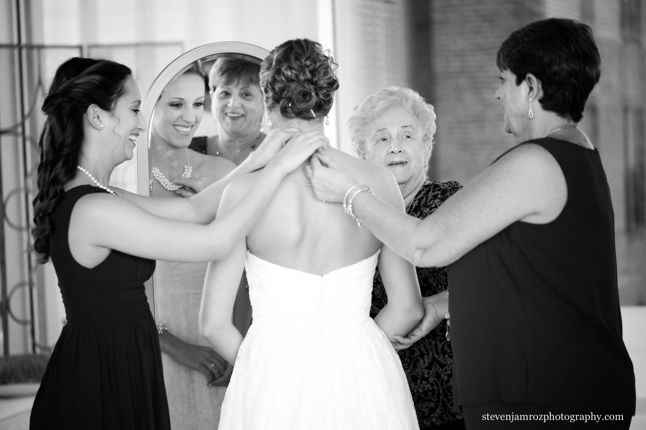 bride-gets-ready-glass-box-raleigh-wedding-downtown.jpg