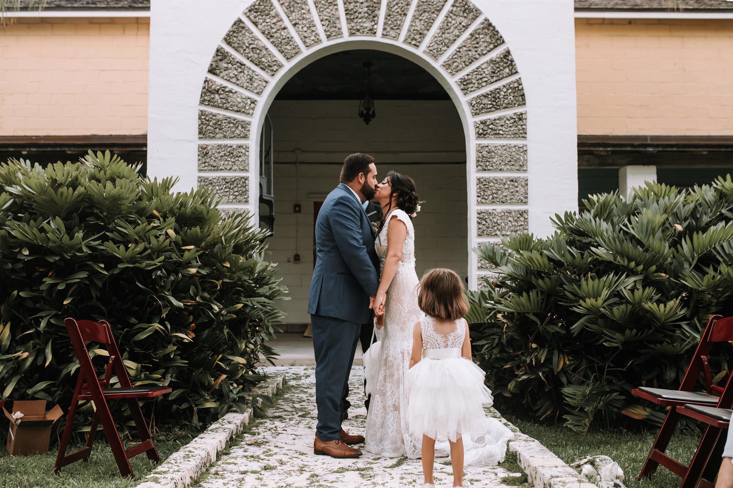 first-kiss-outdoor-wedding-ceremony
