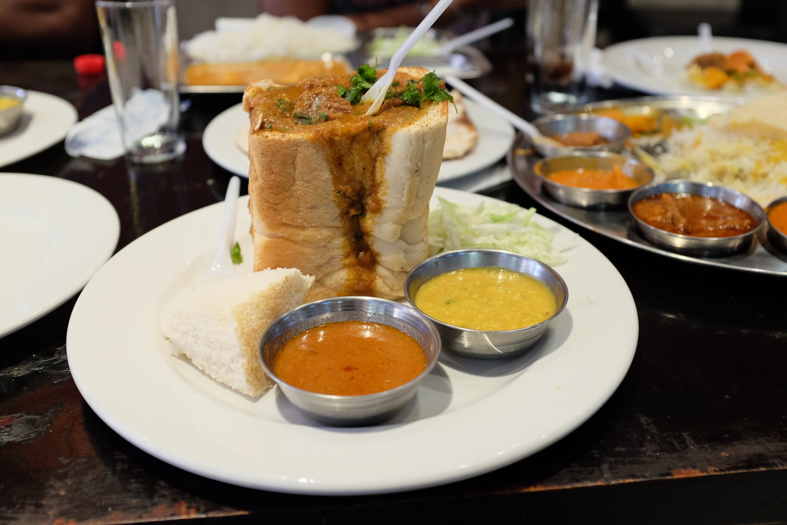 My first bunny chow in Cape Town! Along with dal and gravy.