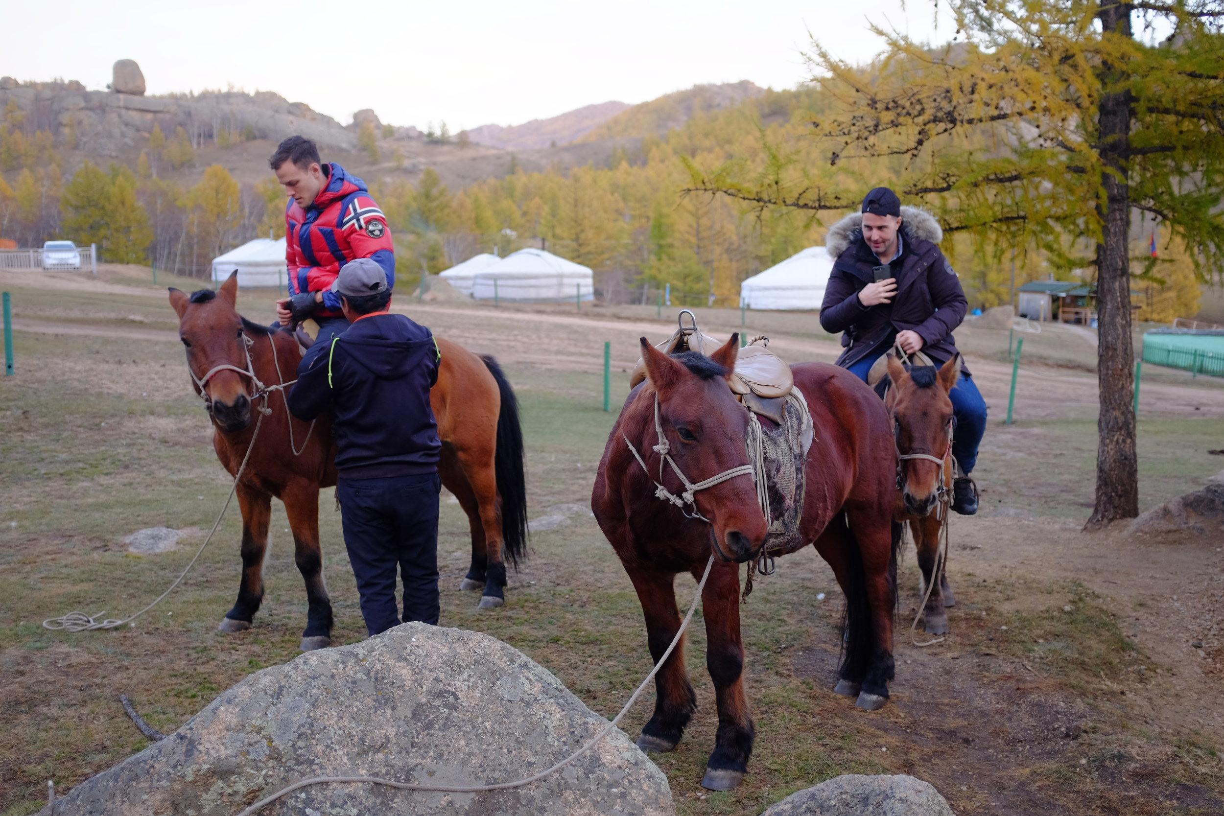 guys on horseback