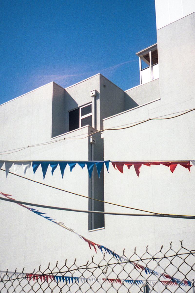 photography suburb melbourne northcote fence flag