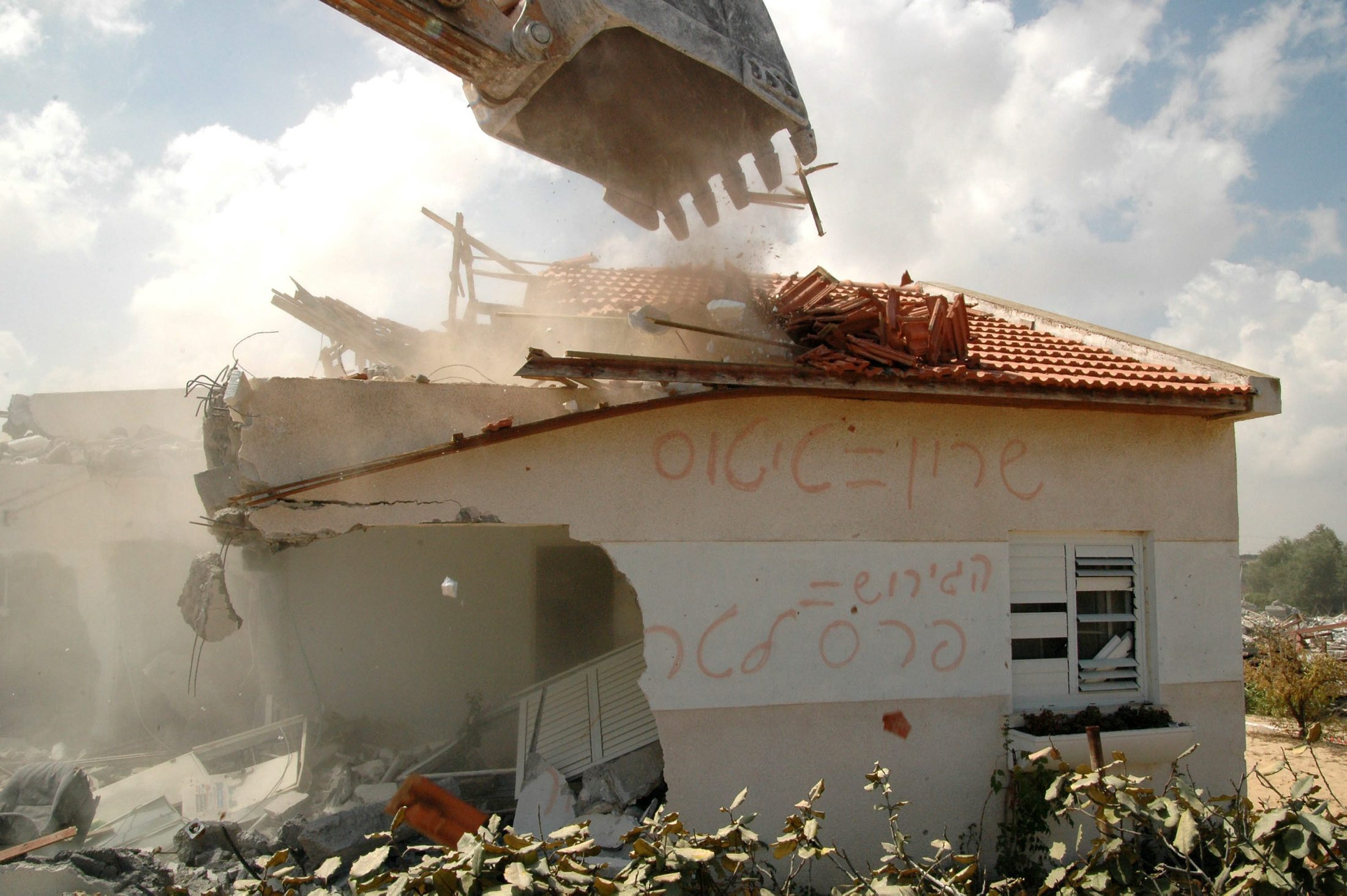 "The last building to be destroyed in Neve Dekalim.  The graffiti reads ""Sharon = Titus"" (via Haaretz)"