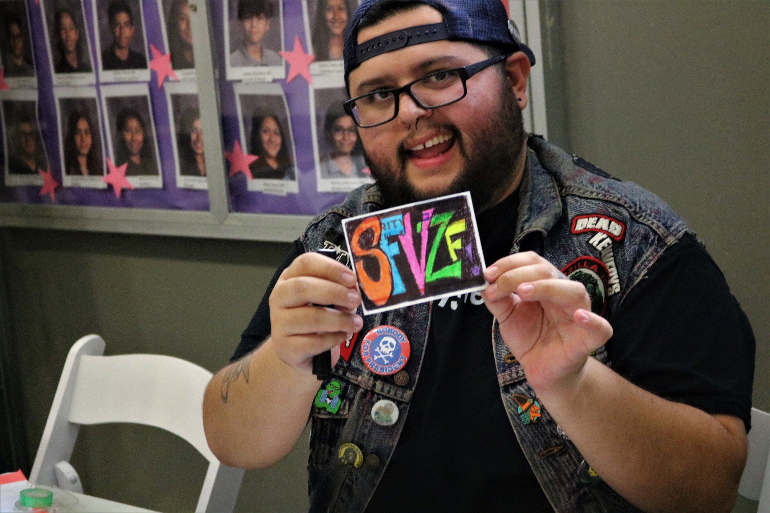NELA zinester Daniel Durazo volunteers in the zinemaking area at SFVZF 2018.