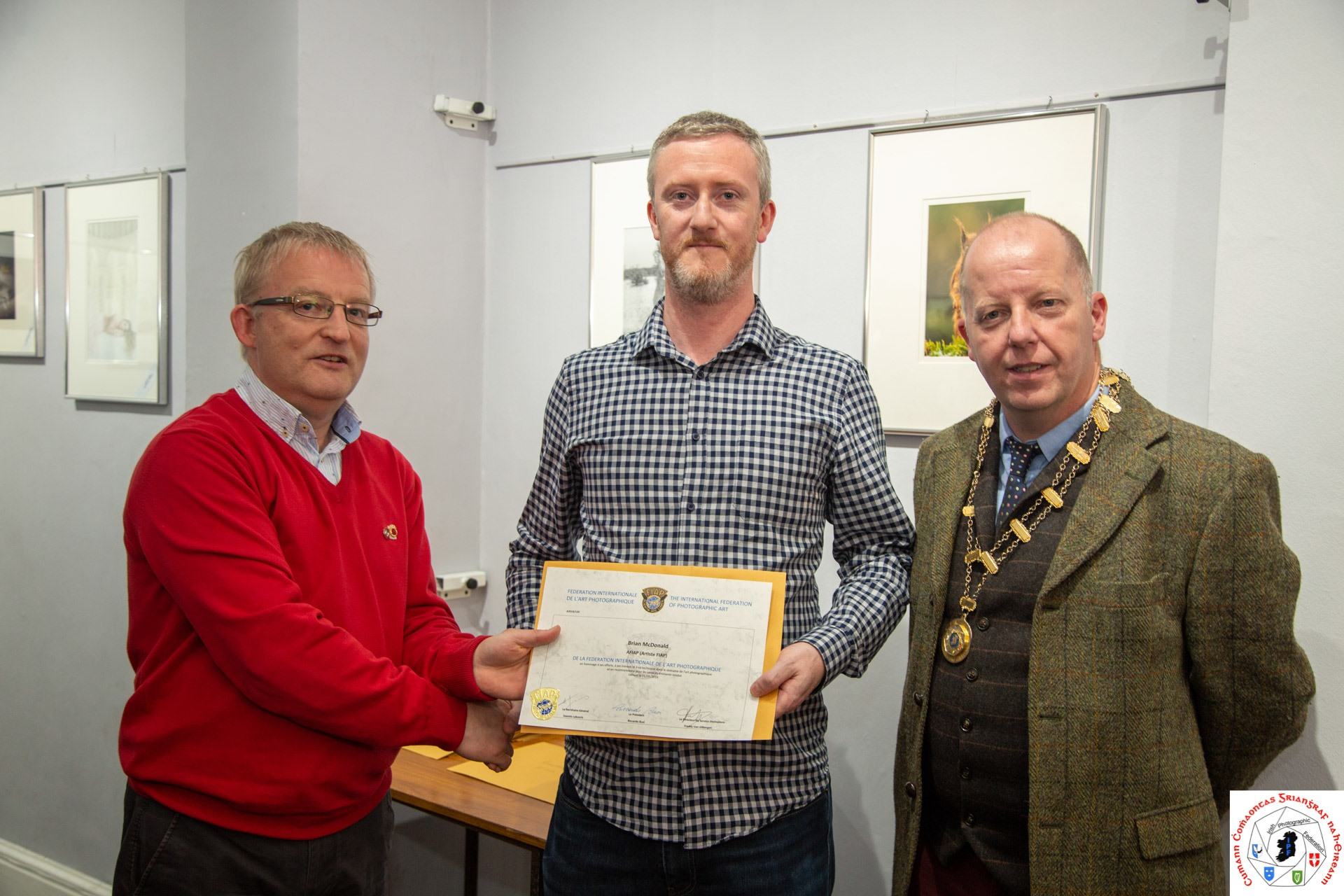 - Paul Stanley Liaison Officer FIAP & Dom Reddin President IPF, presenting Brian McDonald with his AFIAP distinction certificate.