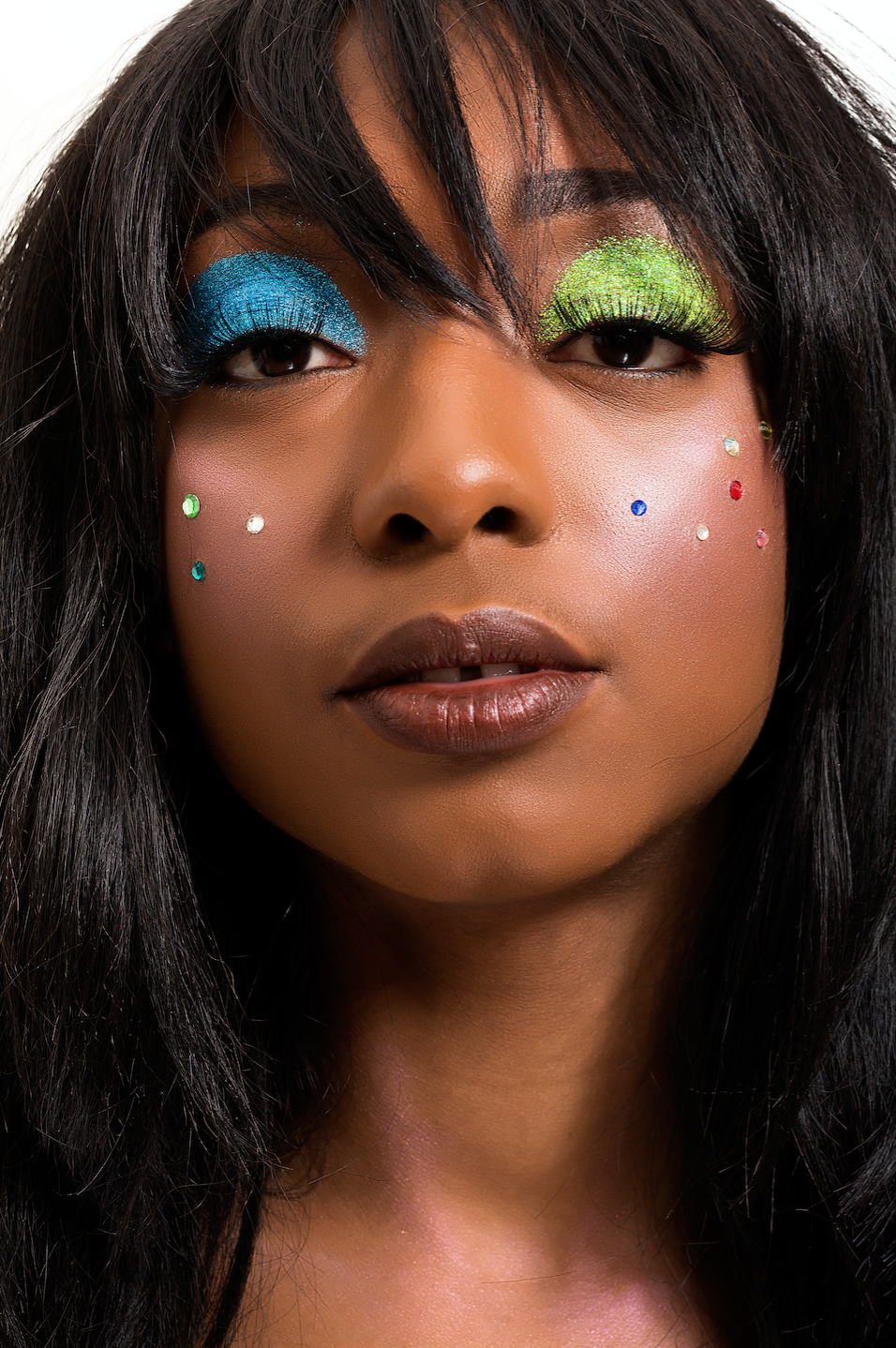 "Makeup used:Lips: MAC ""Diggin It,""Glitter:J.cat Beauty Mineral Base Loose Powder Sparkling Eye Shadow Pigment Blush: Janel Cosmetics,Lashes: BeBella #100, Body Highlight: Anastasia Aurora Glow kit."