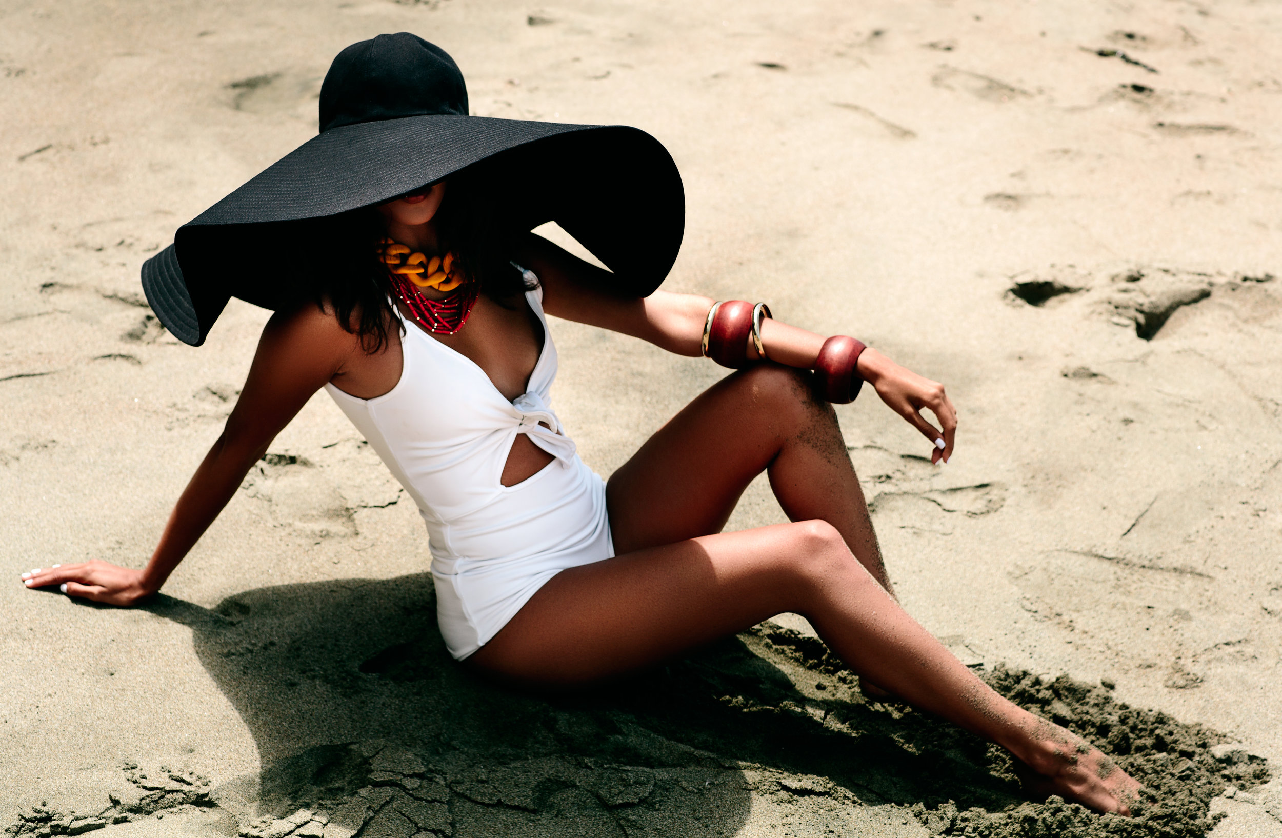Oversized hats are the only way to style on a beach!