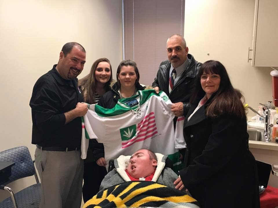 The Briggs family celebrating Ryan Briggs' certification for medical marijuana