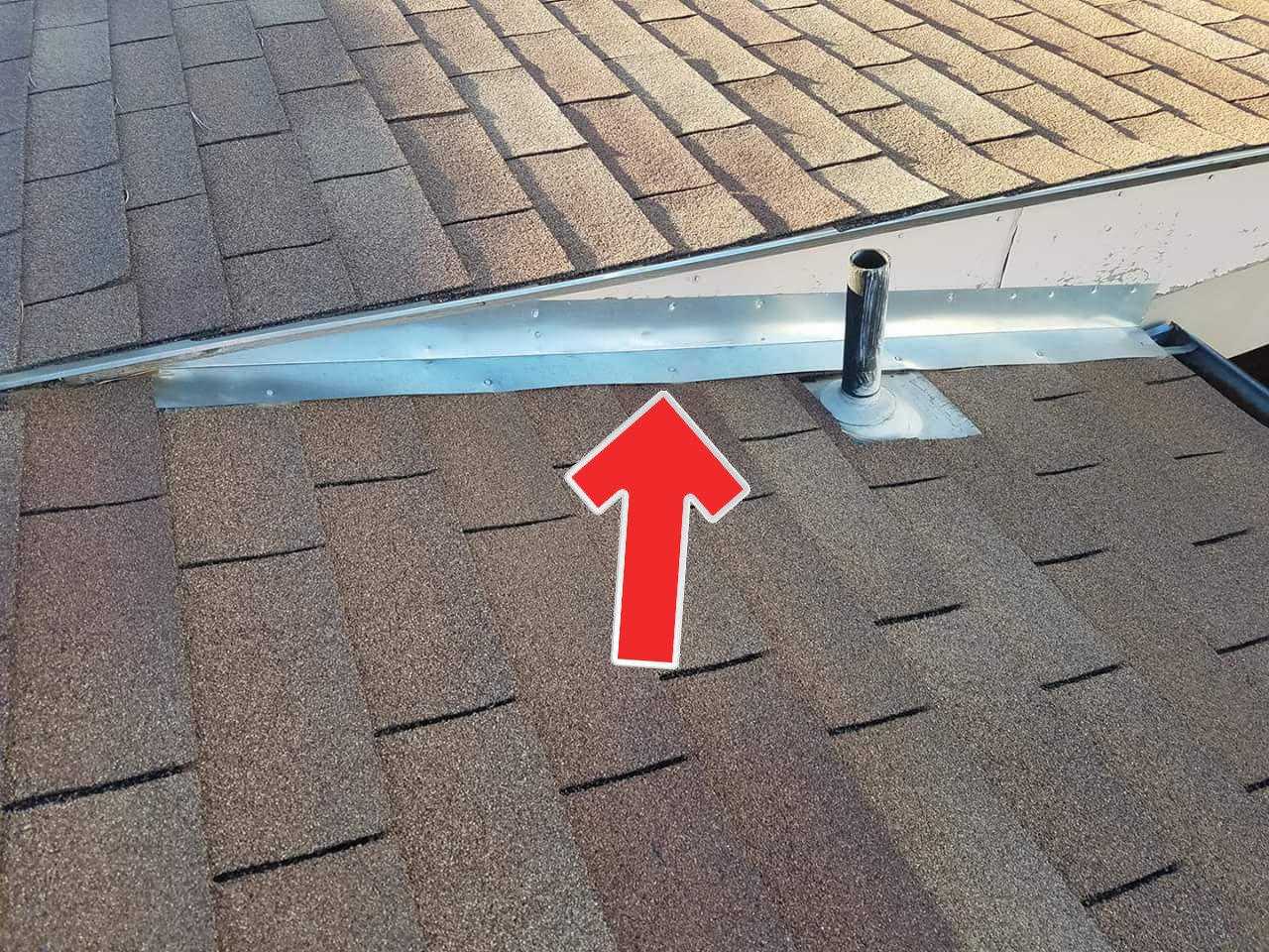 This is the worst attempt I have seen to stop a leaking roof junction. This flashing is serving absolutely no purpose whatsoever.