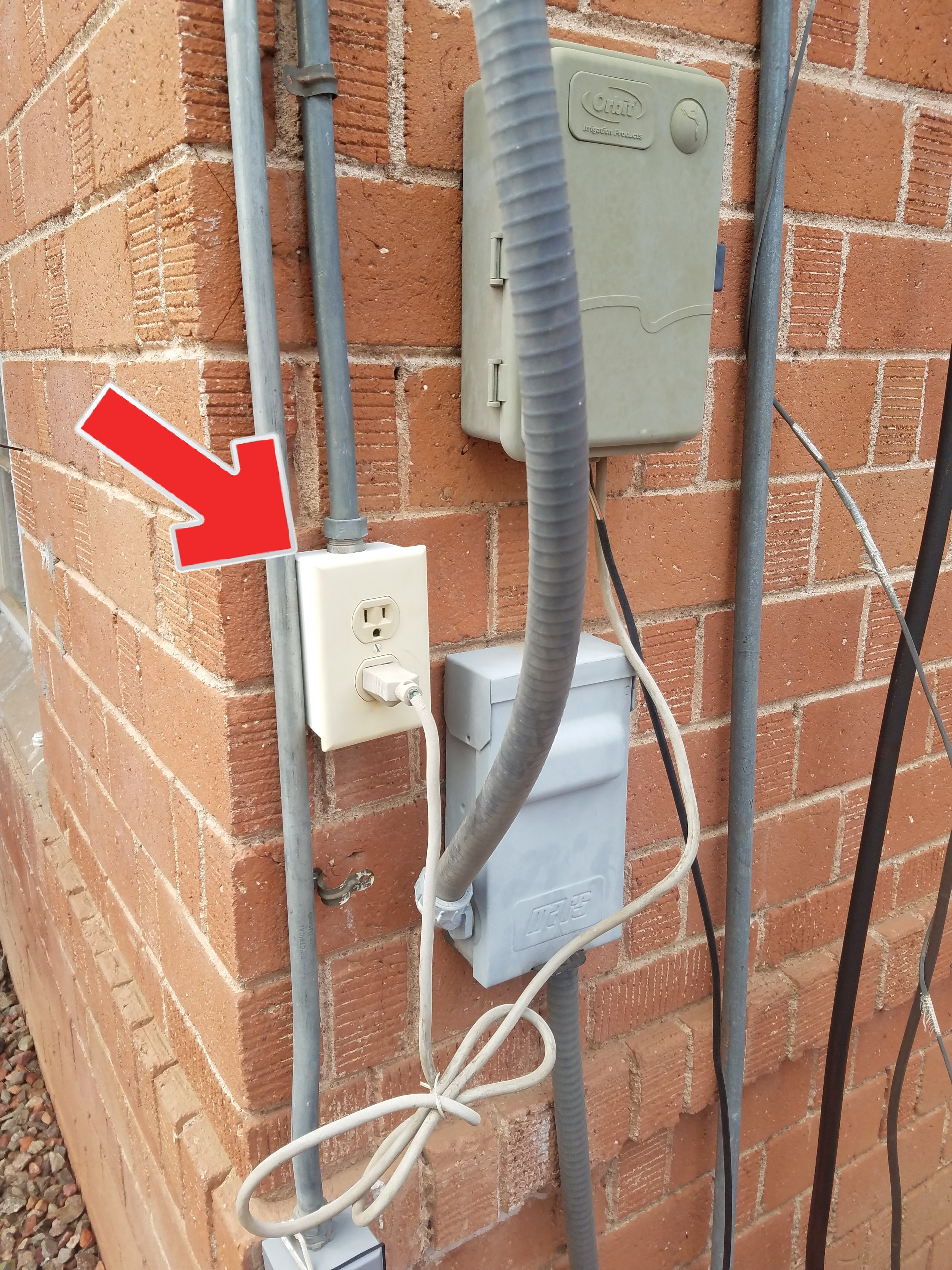 Proper exterior receptacle? Not even close. This is wrong in so many ways. Electrical hazards are among the top issues on older homes.