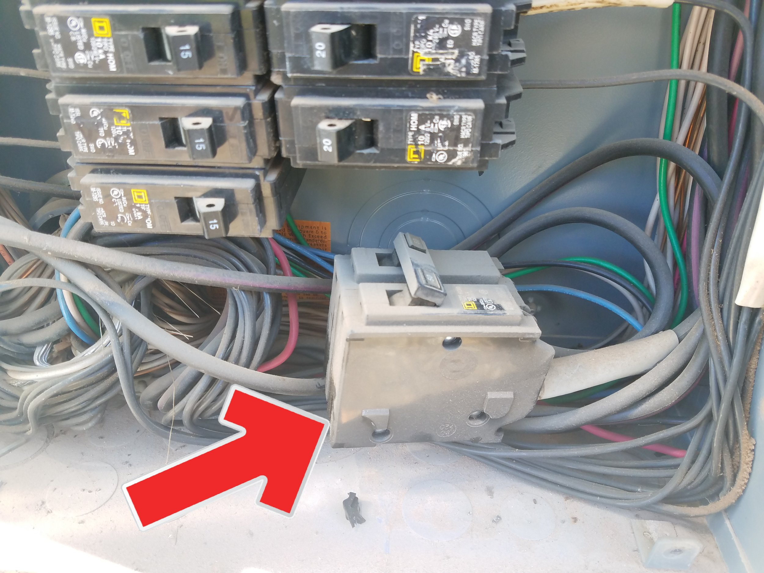 Electrical panel full? Just add another breaker and hide it behind the dead front cover. Totally unacceptable and a huge safety hazard.