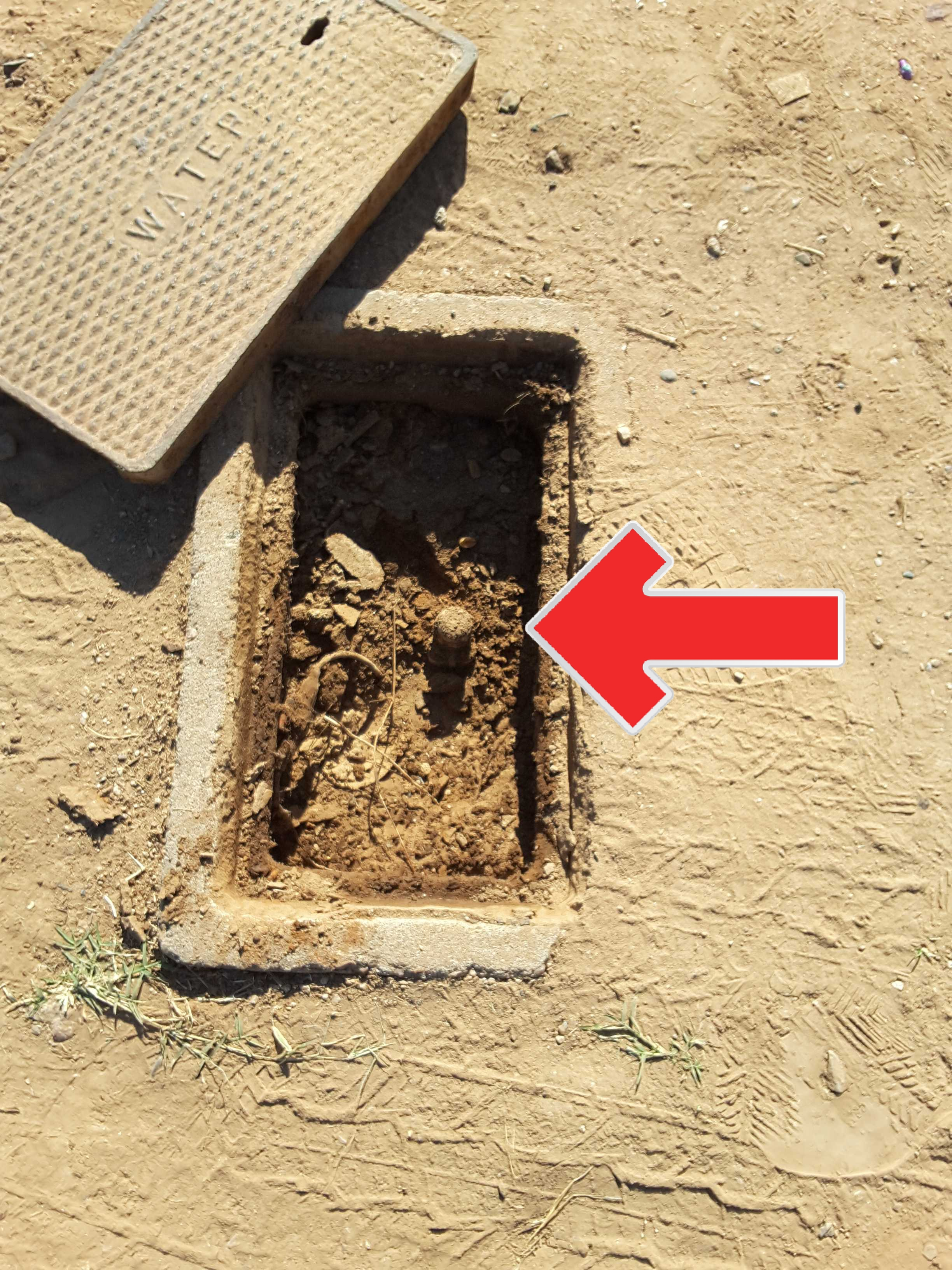A water meter completely buried in soil is an indication of past leaking. Further evaluation by a qualified plumber is recommended.